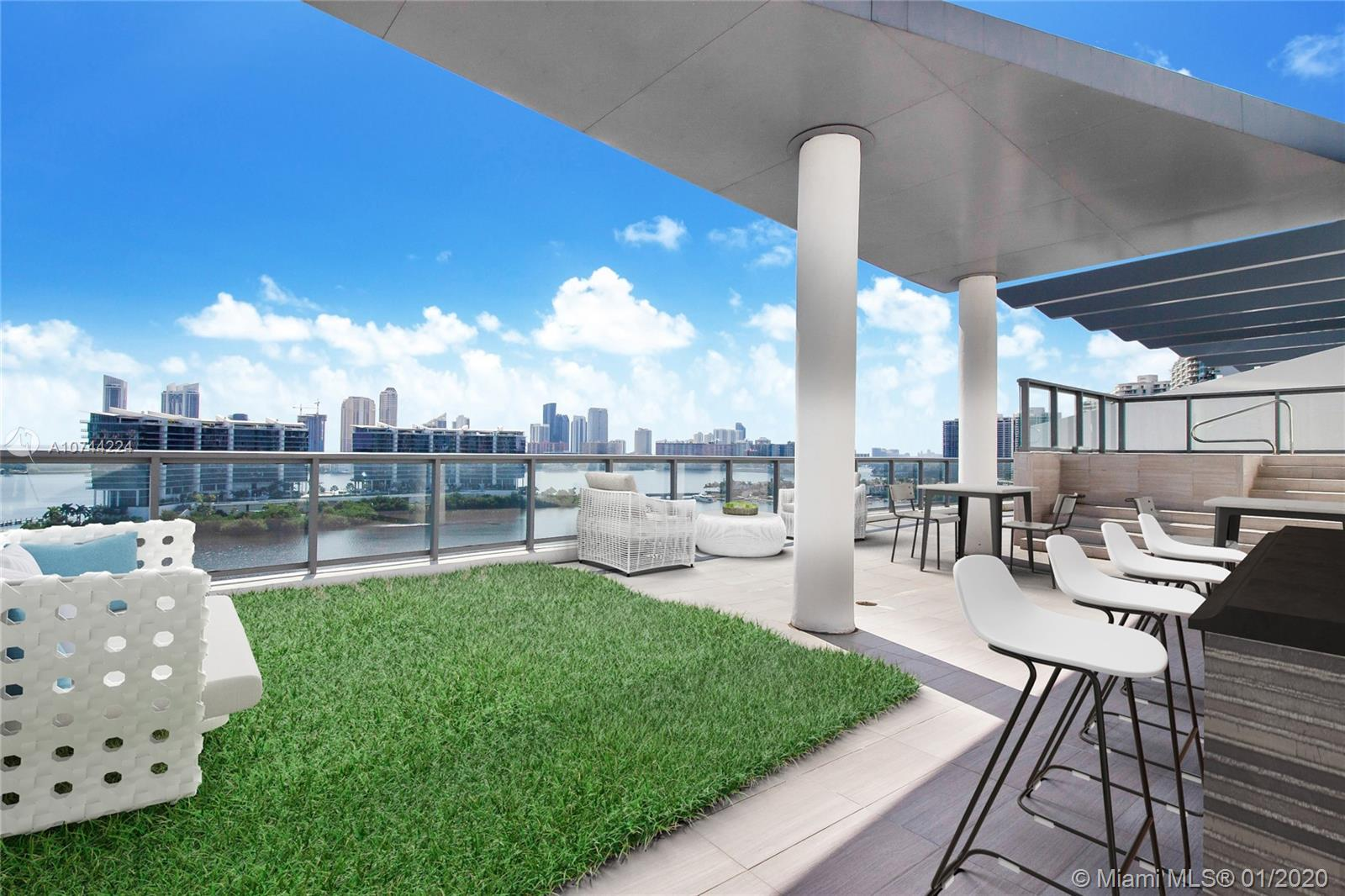 New on Market! Ultra Modern & Expansive Flow-thru corner Upper Penthouse 18 W/, largest PH at Echo Aventura boasting 4,000 SF of living area, private 1,400  SF Rooftop deck overlooking Sunny Isles Beach, the bay and Intracoastal.  Enjoy the BEST of the best views in all of Aventura from your wrap-around terrace compete with outdoor grill/kitchen & outdoor dining area gazing upon the lights of city skyline,  This immense, 4-bed 5.5-bath + den luxury residence is enclosed with floor-to-12 ft. ceiling glass walls allowing for the maximum exposure of endless, panoramic water views, throughout. All living spaces & bedrooms are over-sized, open concept high-end kitchen, private elevator, walk-in closets, & beautiful luxurious bathrooms.