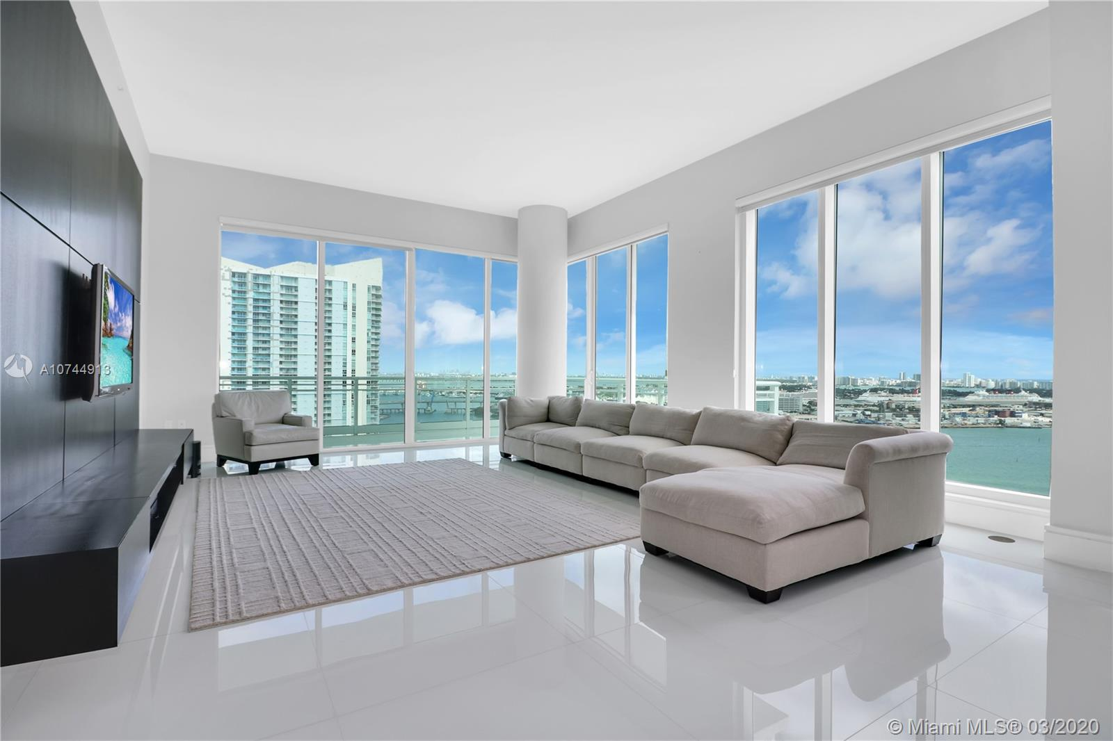 ASIA RESIDENCE FEATURES A PRIVATE ELEVATOR. 12FT. CEILINGS, GLASS BALCONIES AND FLOOR-TO-FLOOR CEILING WINDOWS. MAGNIFICENT WATER VIEWS. 5 BEDROOM, 5.5 BATH WITH MAID QUARTERS, DEN OR MEDIA ROOM, AND SEPARATE LAUNDRY WITH SERVICE ENTRANCE. TOP OF THE LINE STAINLESS STEEL APPLIANCES INCLUDING WINE COOLER AND CAPPUCCINO MAKER. STORAGE AND 2 PARKING SPACES. MUST SEE IT!!!