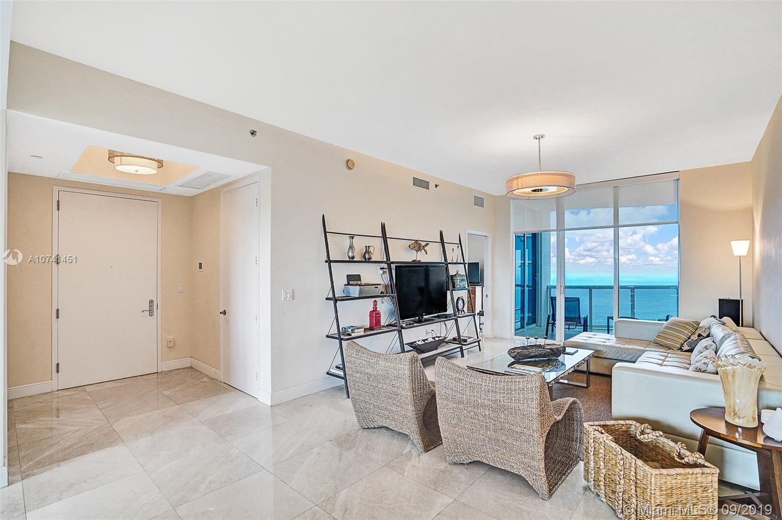 Spacious 3 bed/3.5 bath at Trump Towers III with views of ocean and cityscape. Flow-through unit with sunrise and sunset balconies. Private foyer. Marble flooring throughout with motorized window treatments. Italian cabinetry with island and granite countertops in kitchen. Marble bathrooms. Sub Zero and Miele appliances.