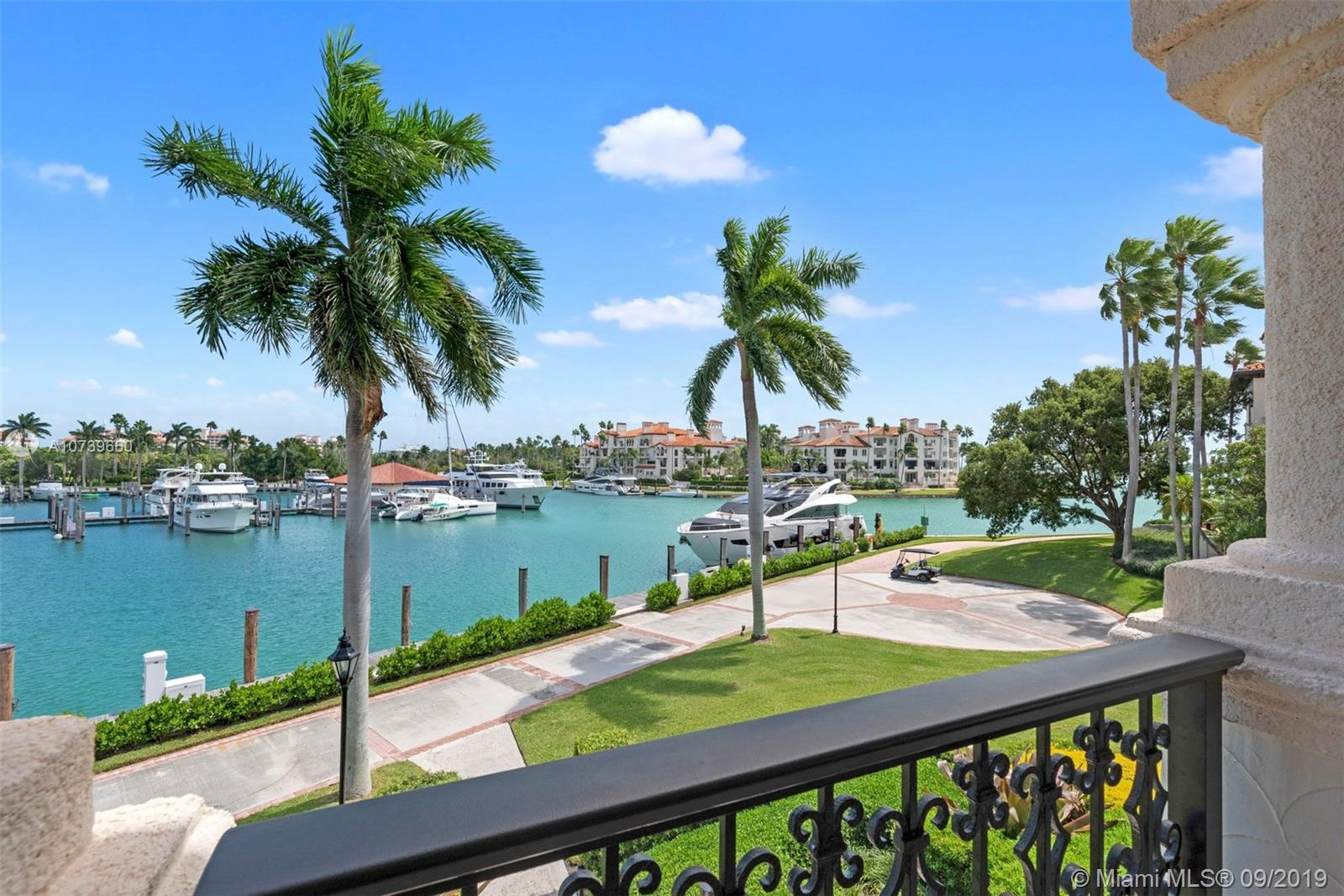 """Island Penthouse - Located within one of Fisher Islands most desired communities. One of only four on the entire island of similar position but each offers a slightly different view. Some features of this 2744 sq ft 3 bedroom 3.5 bath residence include a 14' wood beam vaulted ceiling, 4 terraces. Sale includes 2 storage units, 2 auto and 2 cart spaces. Fisher Island continues to be rated one of the richest zip codes in the US. Bringing the highest standards of living & quality of life to the lucky few that call it home. Private beaches, beach club, restaurants, 16 tennis courts, Pickle-ball, Pete Dye golf course, 2 deep water marinas, private school """"FIDS"""", grand spa and the list goes on & on."""