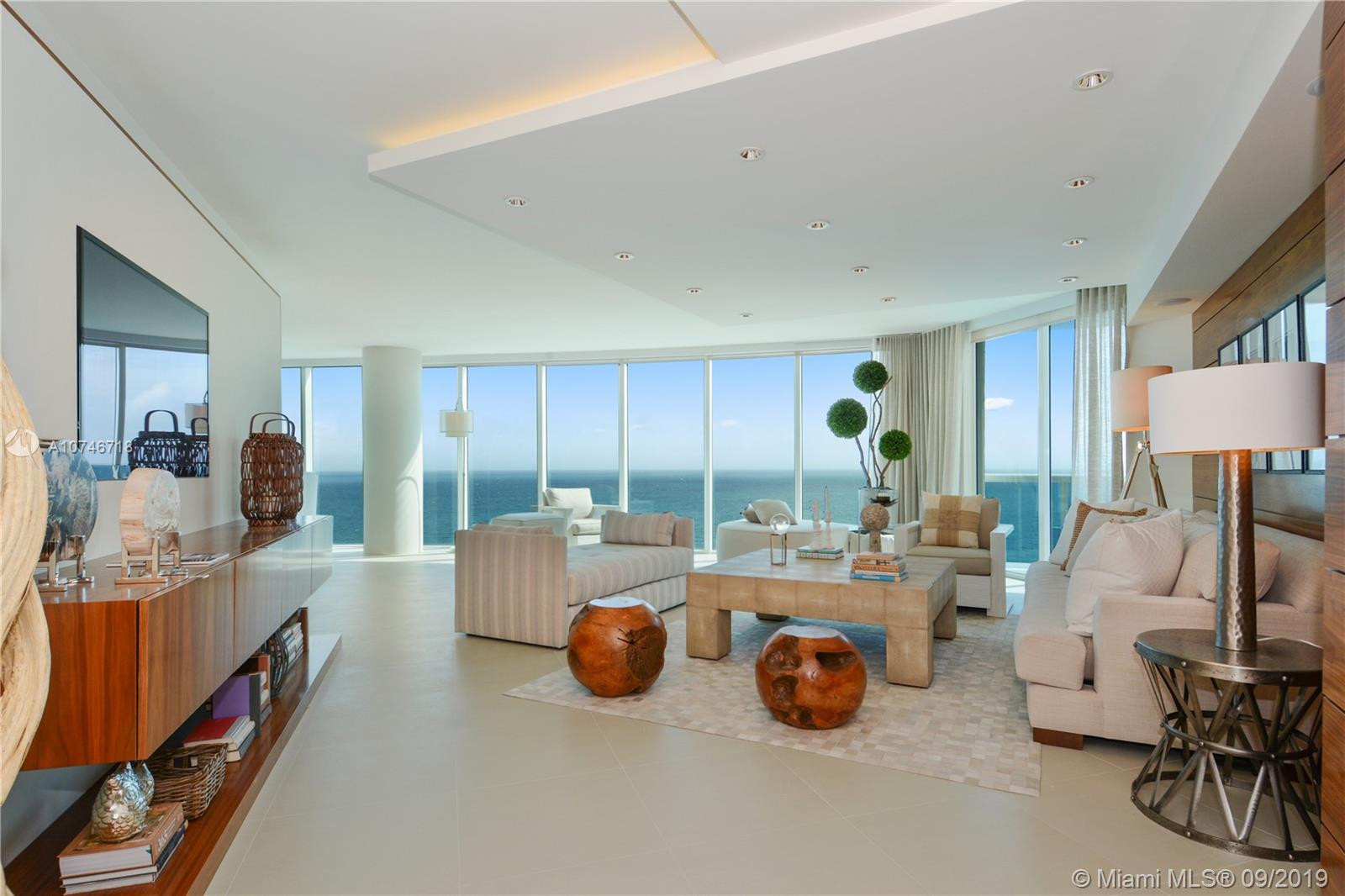 DESIGNED + FURNISHED BY STEVEN G. NEVER LIVED IN! THIS STUNNING MODEL RESIDENCE IN SUPER LUXURY TRUMP HOLLYWOOD SIGNATURE BUILDING ON THE OCEAN IS A PERFECT 10. ENTER FROM PRIVATE ELEVATOR FOYER AND IMMEDIATELY SEE THE BEST DIRECT OCEAN VIEWS TO TAKE YOUR BREATH AWAY. SPACIOUS LIGHT  + BRIGHT WITH 3 ENSUITES PLUS A FAMILY ROOM, 3.5 BATHS + GOURMET KITCHEN WITH HIGH QUALITY MIELE + SUB-ZERO APPLIANCES. BEING SOLD COMPLETELY TURNKEY! STEVEN G DESIGN. NO EXPENSE WAS SPARED. CABANA AVAILABLE/NEGOTIABLE. EXPANSIVE SOARING FLOOR TO CEILING GLASS. A DREAM! RESORT STYLE AMENITIES: TENNIS,POOL,BEACH SERVICES, WINE CELLAR & TASTING SALOON, CIGAR ROOM,LIBRARY.