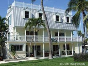 Formerly a licensed 4 unit  Bed and Breakfast with 10 Boat slips. New roof, Water front property on Largo Sound.  Property in need of repair after Hurricane Irma.  A real gem in paradise drive one hour from Miami to Key largo and feel you left the country.  Owner financing available.