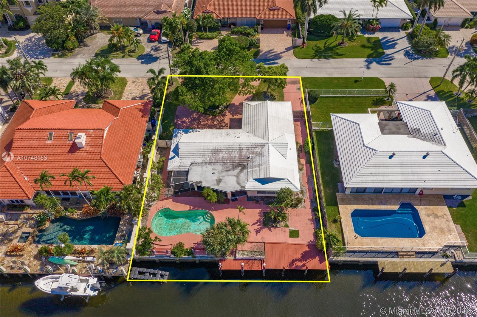 Generously sized waterfront lot with 85 feet on a deep wide canal, no fixed bridges, only 4 houses away from the point and Intracoastal. Large backyard with pool overlooking canal. Coral ridge area with great schools, centrally located. No fixed bridges and only minutes away from open water.