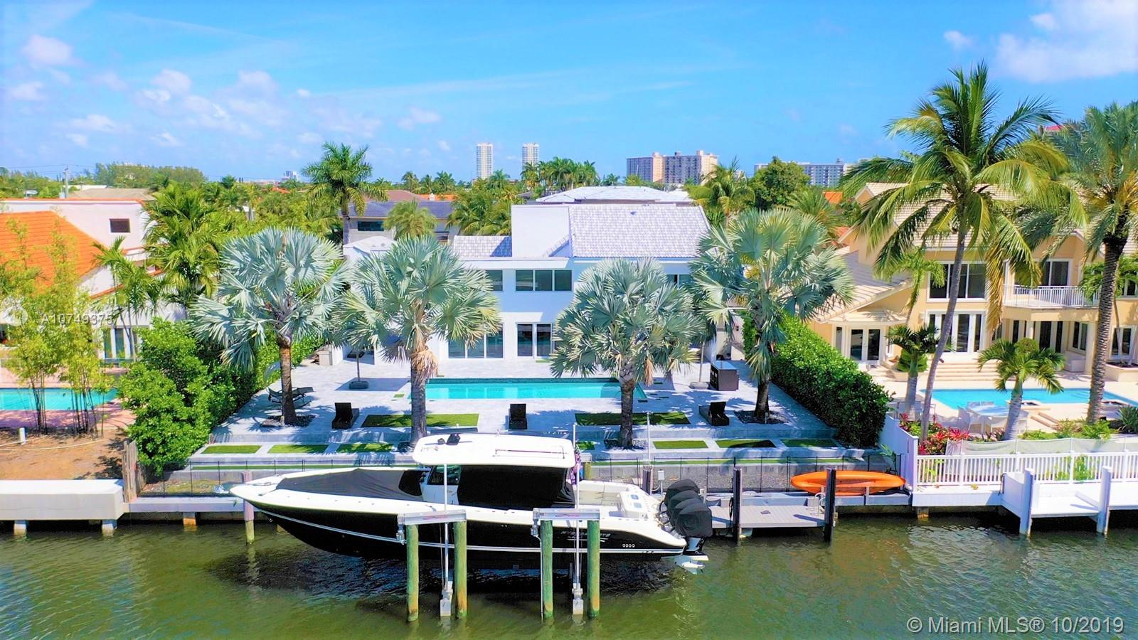 STUNNING COMPLETELY RENOVATED MODERN WATERFRONT HOME IN HIGHLY SOUGHT AFTER GATED GOLDEN ISLES. GATED COMMUNITY W/NO HOA FEES. TOP OF THE LINE FINISHES TO INCLUDE MARBLE FLOORS, GOURMET KITCHEN, SUB ZERO APPLIANCES WITH A BEAUTIFUL CENTRAL ATRIUM BRINGING LIGHT THROUGHOUT THE HOME. PROPERTY EXEMPLIFIES SOUTH FLORIDA LIVING, PERFECT FOR INDOOR/OUTDOOR ENTERTAINING. FLOOR TO CEILING GLASS, 85FT OF WATERFRONT/PRIVATE DOCK/SALINE POOL/THEATRE ROOM/SECURITY SYSTEM/CAMERAS/HOME SURROUND SOUND SYSTEM/LOW MAINTENANCE LANDSCAPING DESIGN/3 ZONE A/C SYSTEM/IMPACT INSULATED PGT WINDOWS KEEPS HOME COOL & QUIET/WATER EFFICIENCY HIGH PRESSURE TOILET SYSTEM/CLEAR ICE MAKER/HIGH EFFICIENCY LARGE CAPACITY FRONT LOAD W&D/OCEAN ACCESS W/NO FIXED BRIDGES. A MUST-SEE PROPERTY. TEXT FOR APPT-SEE BROKERS REMARKS
