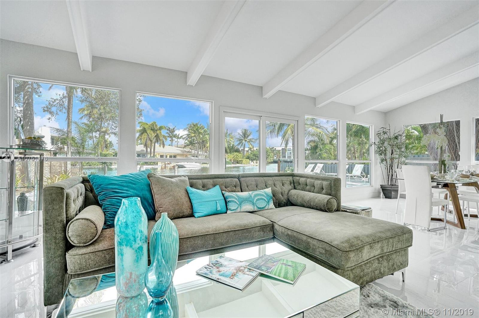 """Live the Lifestyle Of Luxury Waterfront  In This Estate Home,2 Bed 2 Bath High End Renovation In E. Wilton Manors.""""Mid Century Marvel w/ Almost 1900 Sq. Ft.w/ High Volume Ceilings, & Open Concept.Your Chef's Kitchen has Kitchen-Aid Applic.,Custom Quartz Countertops,Mosaic Back  Splash, Familyroom & Diningroom have High Volume Ceilings. Entertain in Your Fireplace Living room. Have Fun Pool Parties with your Diving Pool, w/ Marble Pavers, Dock Your Vessel anytime.Newly Designed Master Suite w/Built in Custom Wardrobes & Views Of the Pool & the River Enjoy Your Spa Styled Master bath w/ Upgrades.Laundryroom & a Bonus Storage room, Perfectly Positioned for the Possibilities to Convert the Garage to Your Third Bedroom.Staged By """"Florida Stage Hands & Design's """" Truly An Incomparable Residence."""