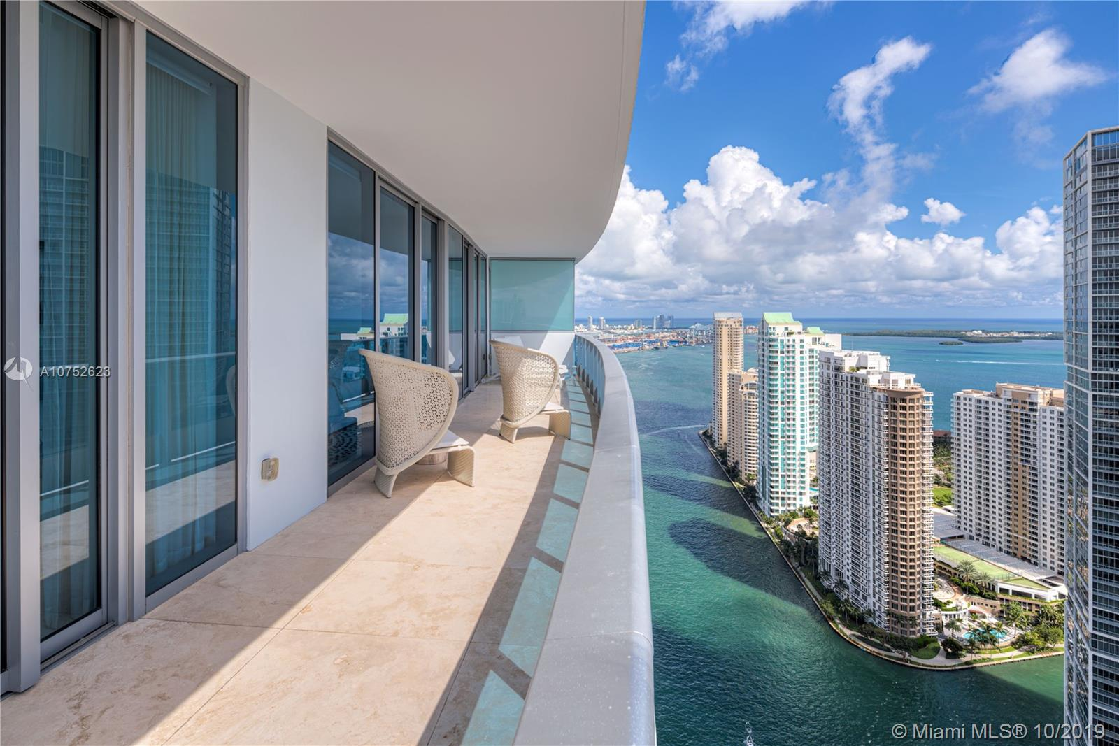 The epitome of luxury in this Epic Residence featuring the finest finishes. The breathtaking & unubstructed views over Biscayne Bay, Brickell & Key Biscayneare stunning. This corner unit with 10ft ceilings with floor to floor ceiling windows creates aninside/outside environment where everyday the light brings a new feel to this space. Limestone floors, built in Millwork entertainment cabinet, solar  shades, upgraded appliances all are details beyond expectations.  Epic has great amenities such as private pool for residences and many other shared concierge-style elements shared with The Epic Hotel. Home to world class dining with Zuma and Area 3. 2 parking spaces.  Epic is your dreamspace you've been waiting for.