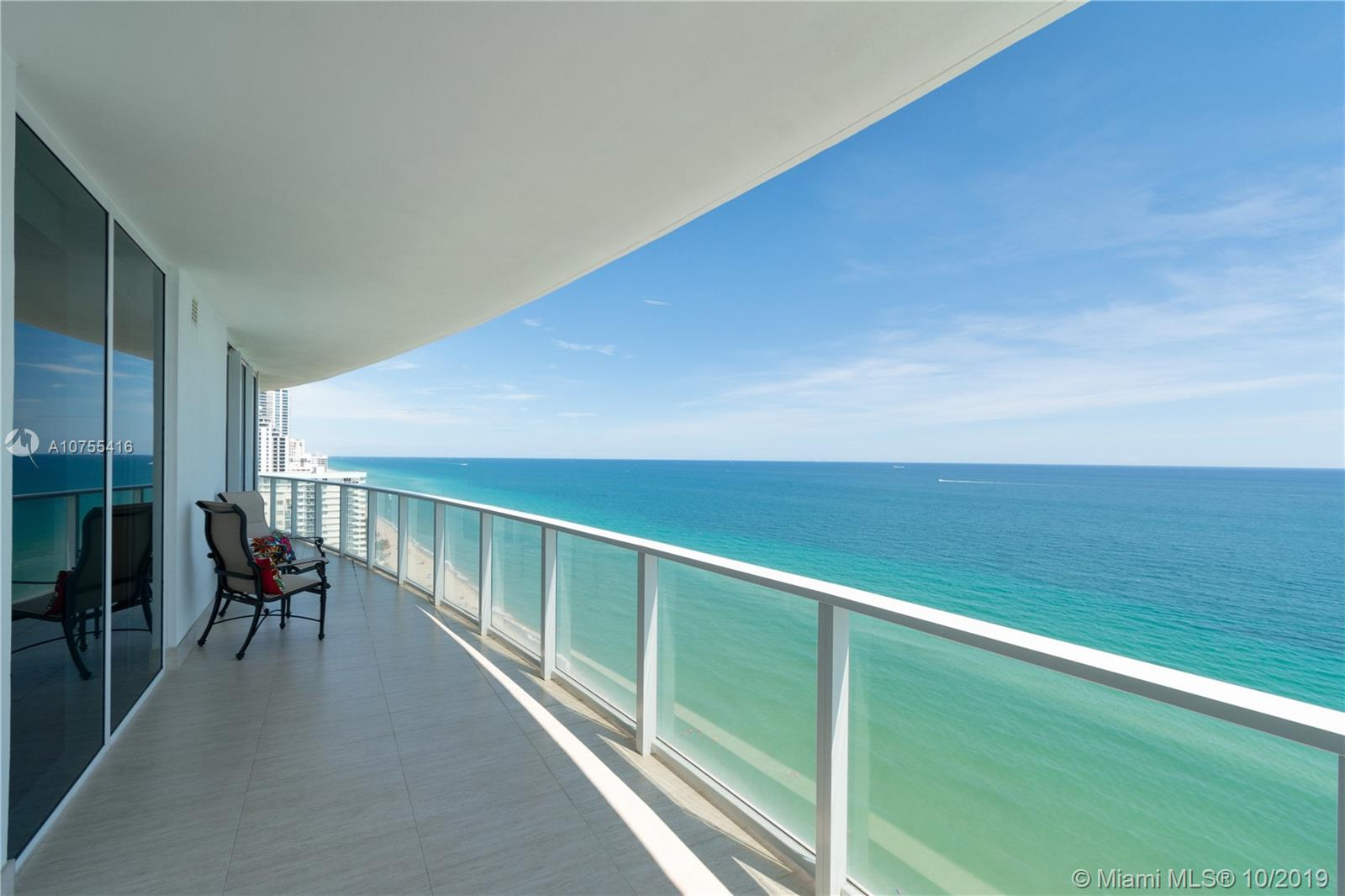 Apogee Beach Condo. Fabulous Boutique Building of only 49 units. This sophisticated 19th-floor oceanfront corner apartment features four bedrooms and four and one-half baths. The 5th bedroom was left open as a den. The unit has three parking spaces and a storage room. Floor-to ceiling energy efficient impact resistant sliding glass doors and windows throughout allow spectacular unobstructed ocean views.This home offers wide open interior spaces, a gourmet kitchen with top-of-the-line appliances, a wet bar, walk-in closets, a laundry room and marble & wood floors. Amenities include direct private beach access, a fitness room, a heated pool, a clubhouse, a sauna, a children's lounge and a billiard room. Full service building with lobby attendant and valet parking.