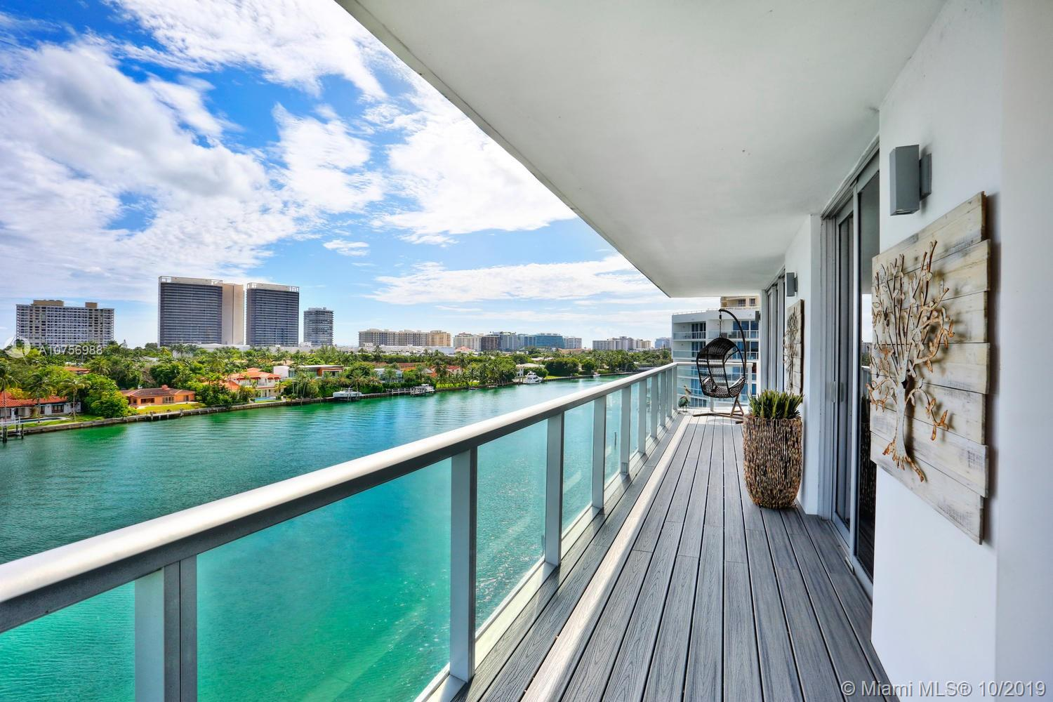Enjoy island-style living in this luxury boutique building, built in 2016 & just a short walk to world-class shopping & dining and the beaches of Bal Harbour. Light-filled living spaces with Porcelain tile flooring , wrap-around balcony & walls of glass that overlook spectacular water views. Currently configured as a 1BR/2BA (owner will reconvert to a 2/2). Sleek, European-style kitchen features quartz countertops & top-of-the-line appliances. Unique building with only 17 residences (3 per floor) and it's own private marina with direct ocean access. Resort-style rooftop deck with 360-degree water views, 45' heated pool, sundeck  & outdoor fitness area. (Unit has an assigned boat dock with an additional $275 association fee for maintenance) Murphy Bed excluded (can be negotiated into price)