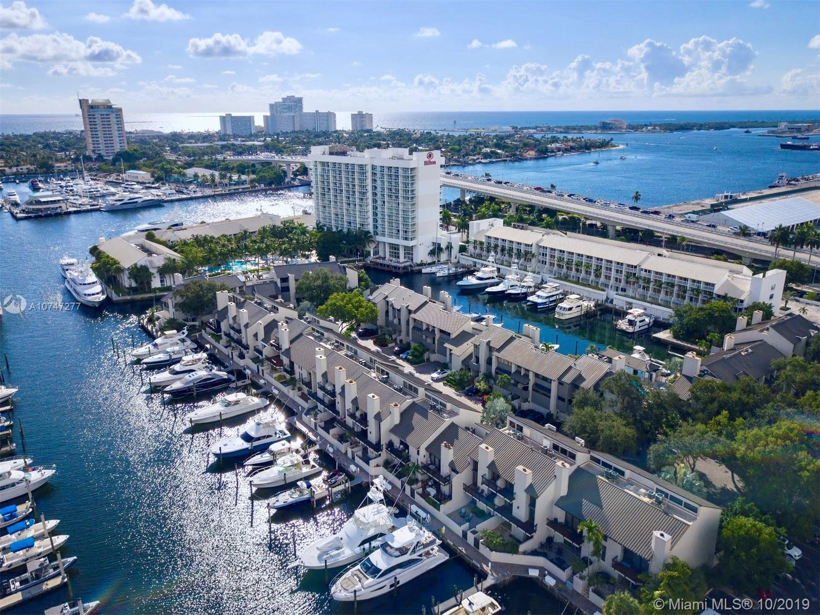 Fort Lauderdale's Best Kept Secret!  Portside Yacht Club is a 40-townhome boating community… just minutes to the ocean!  A True Boater's Paradise!  Deeded 55' boat slip right outside your door!  This stunning multi-level townhome is a 2 BR / 2.5 Bath + loft,  2,226 sq ft residence with vaulted ceilings and oversized windows allowing much natural light into the expansive spaces.  Modern kitchen includes Gaggenau and  Miele appliances and SubZero refrigerator, additionally includes a built-in Espresso maker, steamer and grill.   Beautiful finishes and wood craftsmanship throughout.  Private elevator, several  balconies and one of the largest waterside patios in Portside.  Heated Pool and Cabana Bar area.  Close to Airport, Beaches and Port Everglades Inlet.  And pet friendly!