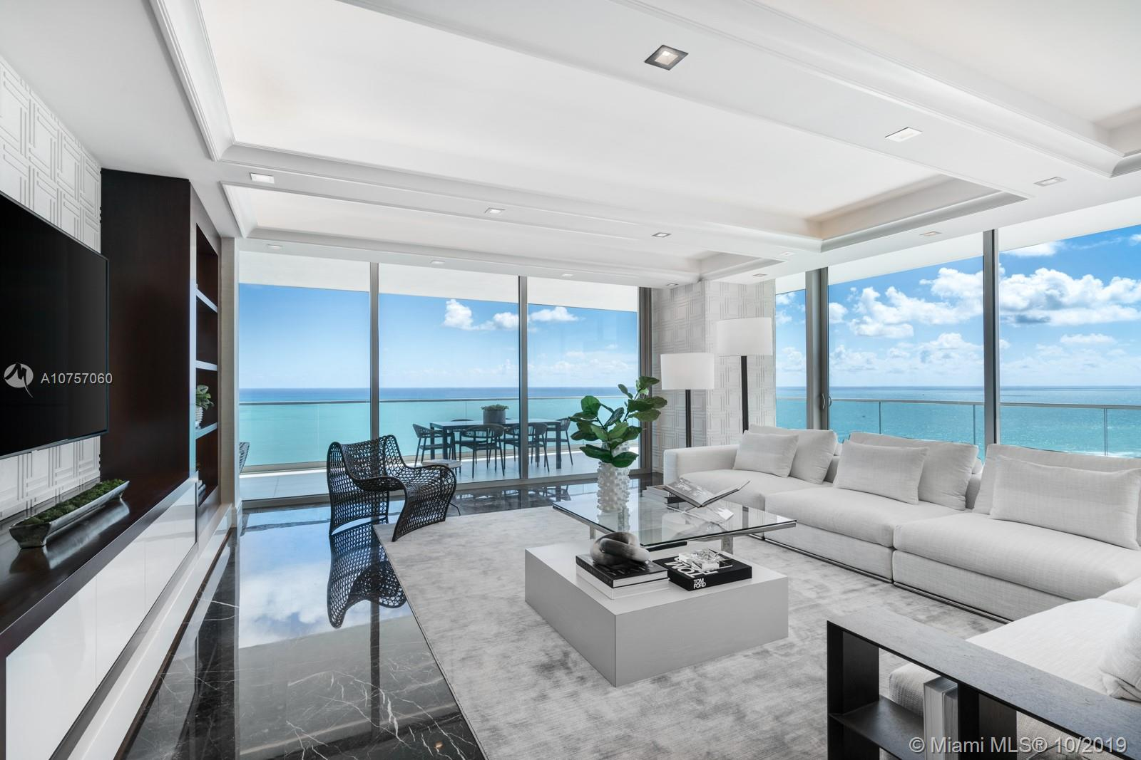 Oceana Bal Harbour's Flagship Floorplan! This South Corner of the South Tower is designer finished with the highest caliber of materials. The oceanfront flow-through residence offers 4,185 SF of living space, 3 bedrooms, Den, Family Room, 4.5 baths and more than 1,500SF of wrap-around terrace with the coveted East to West ocean & Miami skyline views. With over $1MIL in renovation upgrades including a brand new gourmet kitchen, custom bar, an enormous Master with 2 walk-in closets and an ultra modern bath, as well as stunning millwork throughout. Oceana is the top tower in Bal Harbour offering 400 feet of beachfront property, 24-hour concierge services, poolside restaurant, tennis, spectacular spa, gym, resort style pool with cabanas and more. And the 01 line is its most desired plan.
