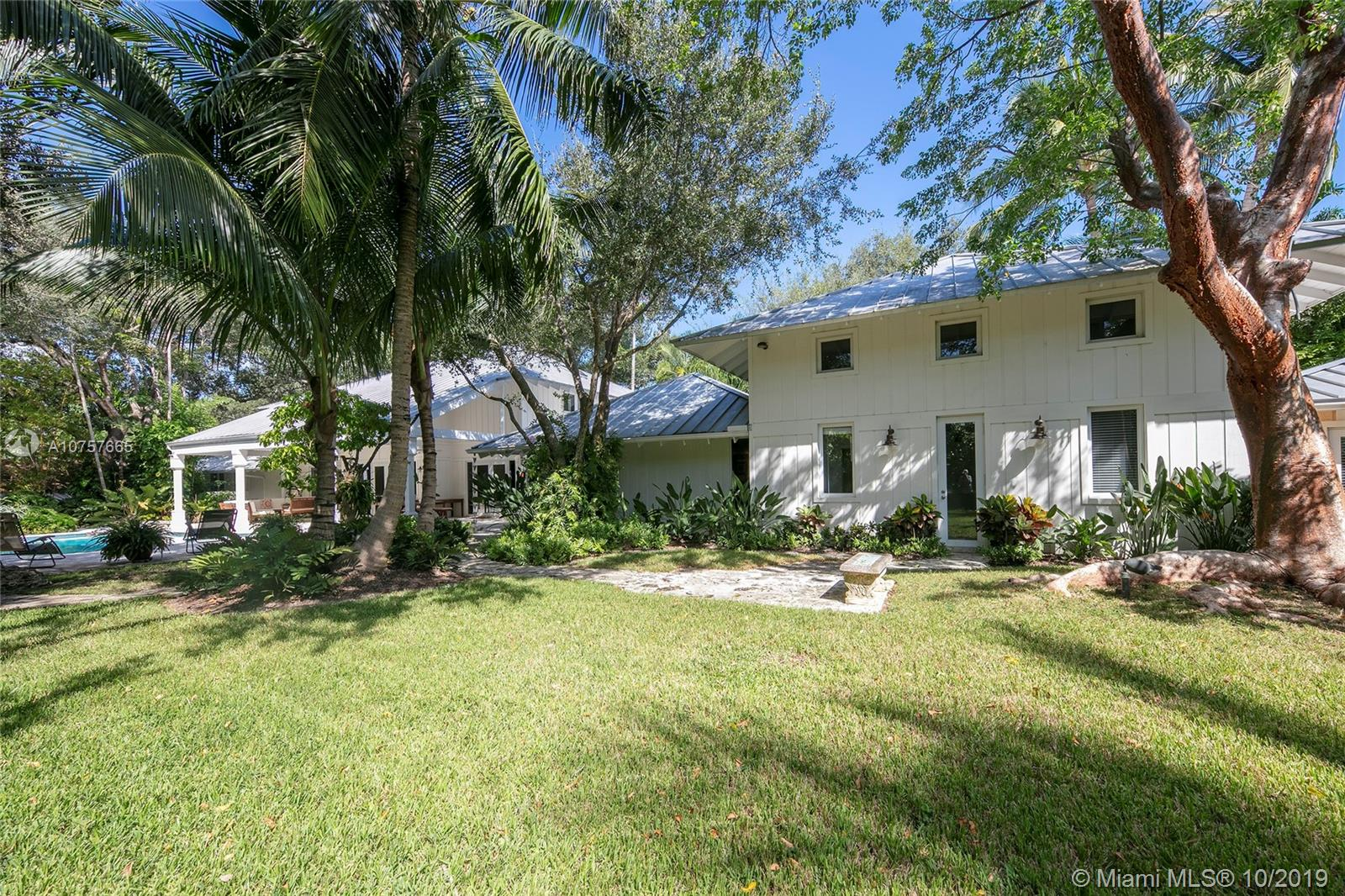 Gorgeous Florida Vernacular on an Oak, Gumbo Limbo, & fruit tree studded 37,462 sf lot in Ponce Davis trophy location cul de sac of only 3 homes. Lush landscape, verdant views make this home a daily retreat. Many updates in 2012/2014, Limestone & wood floors, impact windows/doors, chefs kitchen w/gas Wolf stove, espresso machine, wine cooler. Double height entry atrium lit by a skylight. Living, breakfast & family rms all open to large covered terrace, pool,yard. Coralina walkways to a chickee hut & N-S tennis court. Downstairs master wing open to the terrace, enjoys an office, his/hers walk ins & glamorous bath suite. Staff area & guest/in-law w/an exterior door. Gym loft, laundry/staff area. 2 upstairs Jack & Jills w/vaulted ceilings. 2 car garage can accommodate lifts. 3 guest prkg bays