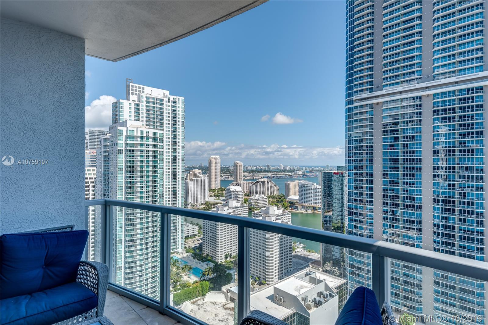 BRICKELL LIVING! Skyline & partial bay views await you in the heart of the Brickell area. Walk to all of the restaurants, pubs, entertainment venues, gourmet shops & stores in the area. Enjoy building amenities that include an oversized pool deck, fitness center, billiards room, golf simulator, 24-hour concierge & 2 on-site casual restaurants. Pet-friendly with 24hr valet. Unit features wood & marble floors, kitchen with glass tile backsplash & marble countertops, interior washer & dryer plus an exterior balcony facing east towards the bay.