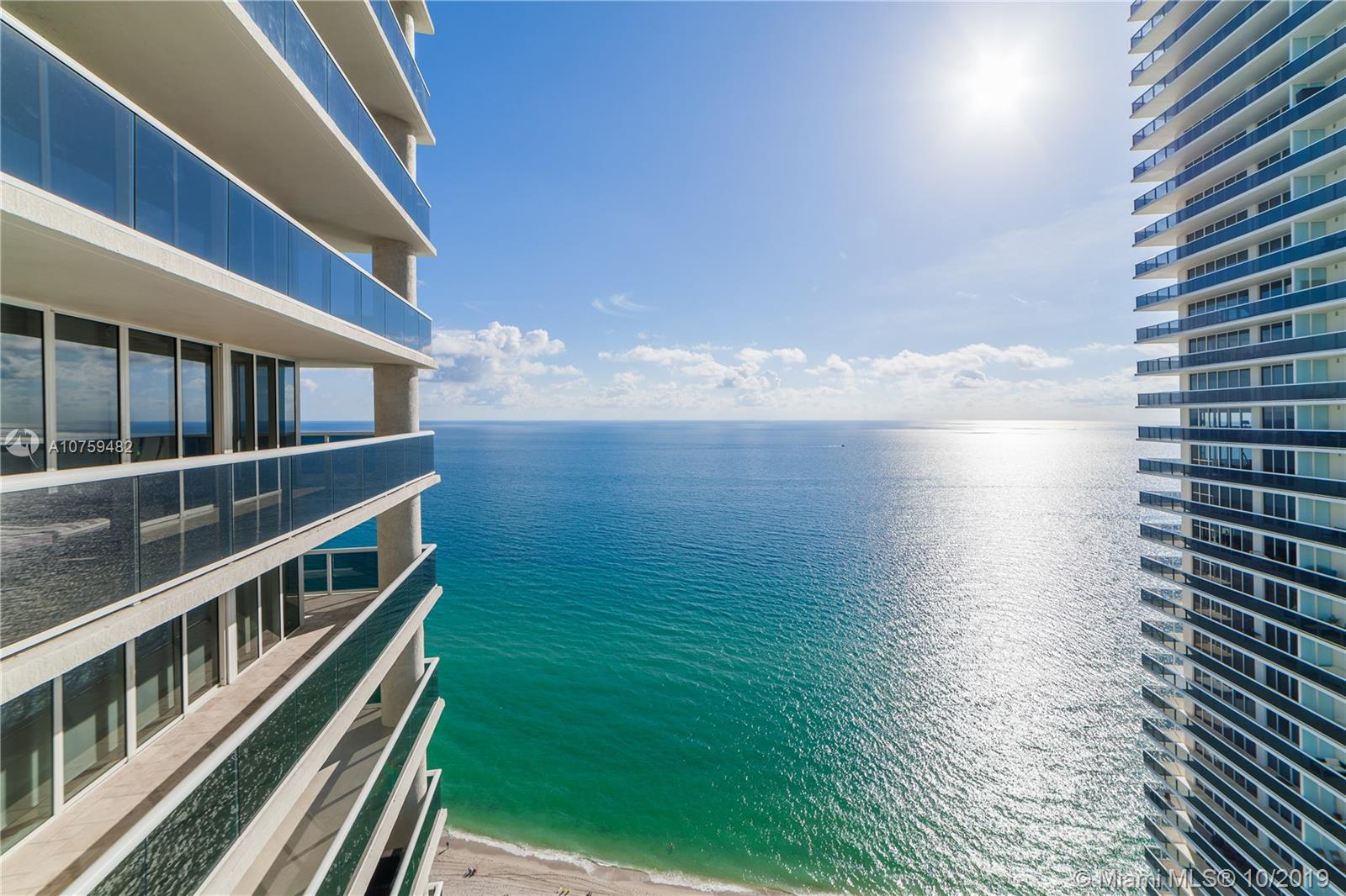 OCEANFRONT LUXURY CONDO with amazing ocean and city panoramic views from 33 FLOOR (2 balconies 457 s.f.) from this 2 bed/2 bath 1782 S.F. corner unit. 5 Star Three Tower complex featuring a 50,000 S.F. full service SPA & fitness center overlooking the ocean, restaurant & full bar w/pool service & delivery. Full time concierge & 24 hours valet parking & security. Top-of-the line appliances, great furniture, laundry room inside unit, huge closets & open kitchen. The best amenities on the beach in a growing city centrally located between Miami and Fort Lauderdale. Next to shopping, golfing, restaurants, horse racing, water sports + boating & more. This is amazing opportunity, call listing agent for private showing!!!