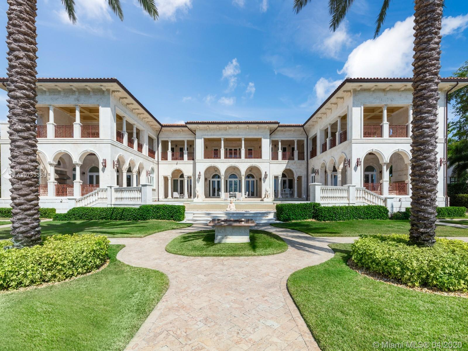 Two story Palatial/Neo-Classical Italian style villa designed by renowned architect Ramon Pacheco. This Dream home is 18,073 total sq feet, w/14,443 adjusted living area, facing south on wide Gables Estates lagoon with marble veneer walls & custom carved stone elements throughout. 200 feet of new seawall with 140 foot dock. 2,888 sq feet first floor covered terrace & 1,222 sq feet second floor covered terrace area. Huge Master suite with his/her bath with huge walk in closets, 5 additional En suite bedrooms & 2 bedroom staff quarter. Exquisite Venetian Plaster with carved plaster moldings throughout, 2 story foyer with crystal chandeliers. Custom crafted kitchen with butlers pantry, 600 bottle custom wood wine cellar. Library/Office with fireplace, private side entry. Huge Gym w/full bath.