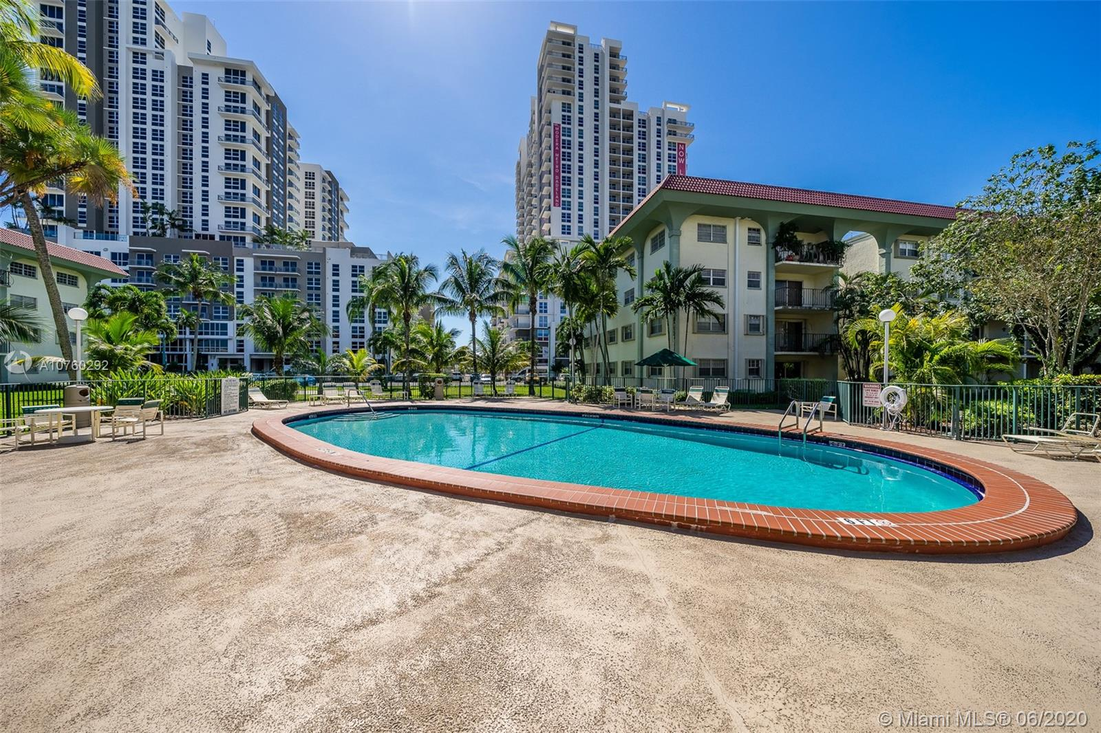 .PRICE JUST REDUCED Well maintained and ample spaced corner unit, 2 bedroom, 2 bathroom Condo. Exterior view from the balcony, within a four floor building; unit tiled throughout, located on the second floor. Ample closet space. Two elevators provide access to unit. Accordion shutter on balcony sliding door.  Amenities include : security gate, Club house with gated community pool.  Maintenance fee includes basic cable and water. Near the University of Miami, Dadeland Mall with easy access to restaurants and metro rail nearby. Many public transportation options as well. No special assessment. Has the 40 year certificate.