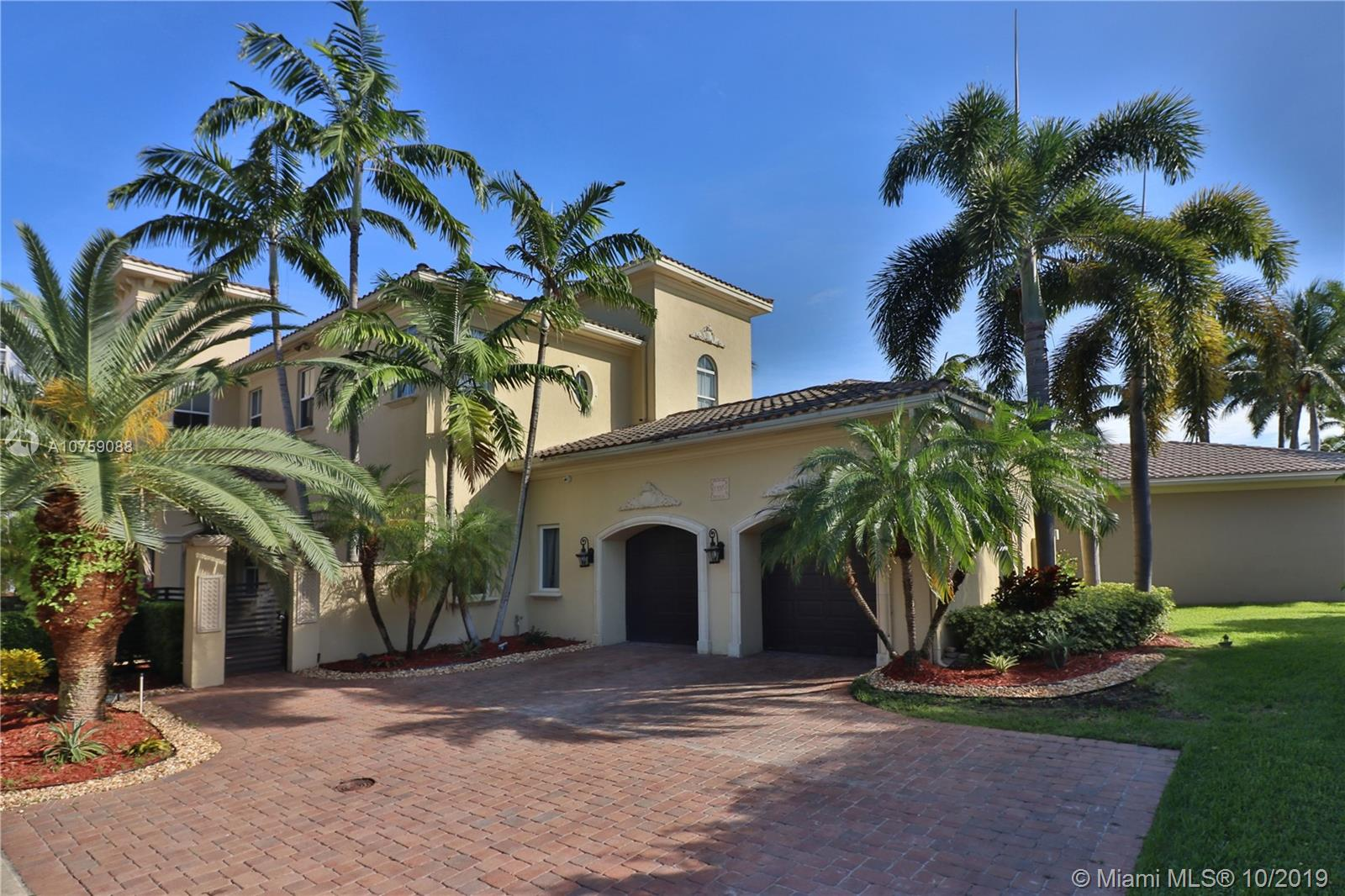 """WATERFRONT ESTATE MODERN ELEGANT 2 STORY HOME IN PRESTIGIOUS GUARD GATED COMMUNITY. BEAUTIFUL MOVE IN CONDITION WITH 24/7 SECURITY PATROL IN HARBOR ISLANDS.  RARE OPPORTUNITY.  SPECTACULAR PANORAMIC INTRACOASTAL VIEWS AS SOON AS YOU ENTER. 6 BEDROOMS WITH """"EN SUITE"""" BATHS. MARBLE FLOORS THROUGHOUT LIVING AREA, FORMAL DINING ROOM, SPACIOUS LIVING ROOM WITH WOOD BURNING FIREPLACE.  FAMILY ROOM OPENS TO A NEW GOURMET CHEF'S KITCHEN. TOP OF THE LINE APPLIANCES, CENTER ISLAND, WOOD CABINETRY DESIGNED WITH THE FINEST OF FINISHES.  4 BEDROOMS UPSTAIRS PLUS AN OFFICE/SITTING ROOM IN MASTER BEDROOM WITH PRIVATE BALCONY & SPIRAL STAIRCASE LEADING TO THE POOL OVERLOOKING THE INTRACOASTAL. PRIVATE DOCK CAN ACCOMMODATE A 30-35 FT. YACHT PLUS 2 HYDRO LIFTS EQUIPPED FOR A YACHT & JET SKI. ORIGINAL OWNER."""