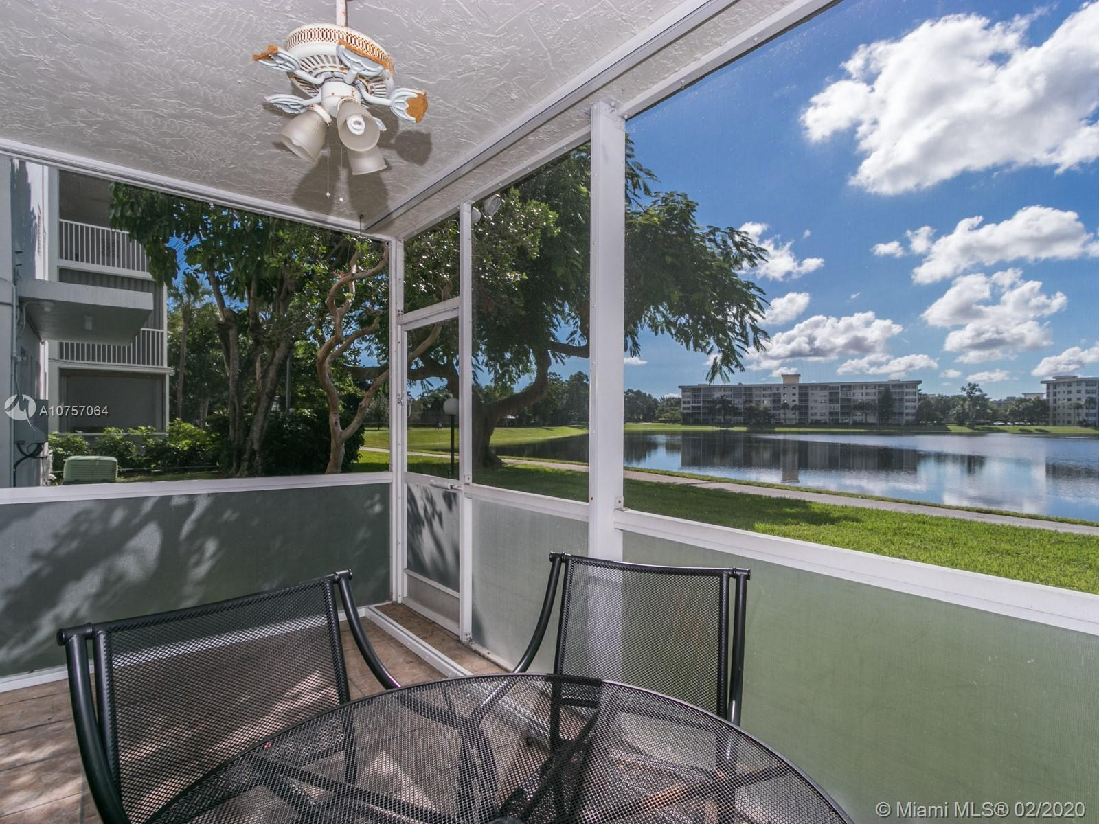 Beautiful 1st floor condo with screened in patio and lake view! The unit has impact windows and accordion shutters to close off the balcony. The kitchen has updated appliances and granite countertops with a kitchen pass through. New AC and new washer/dryer. Both bathrooms are completely updated as well. Palm Aire is directly across from the Isle Casino, close to shopping, restaurants and more!