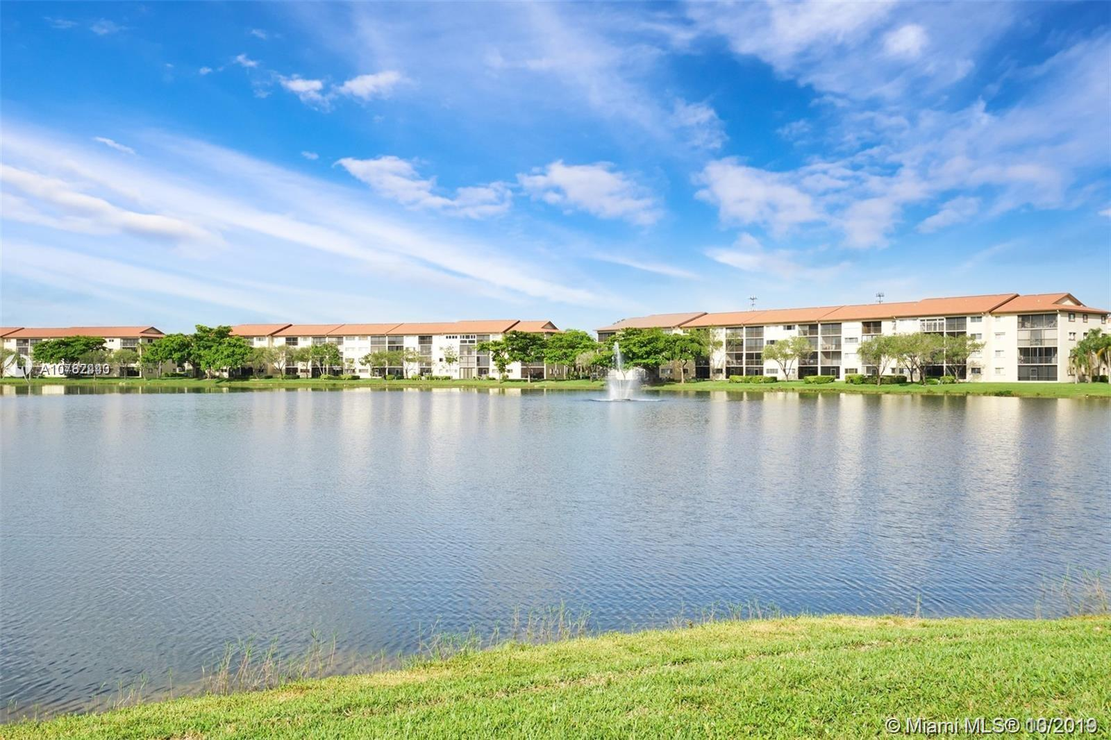 Resort style living with lake views from this sought after spacious corner unit.  2 bedrooms, 2 bathrooms, walk-in closets, ceramic tiled floors, washer & dryer, pantry, screened balcony, lots of amenities that include movie theater, tennis, indoor & outdoor swimming pools, 2 health clubs, sauna, spa, card tables, shuffleboard, library, restaurant, golf club, houses of worship, 55+, okay to rent, free transportation to Pembroke Lakes Mall, and shopping area.