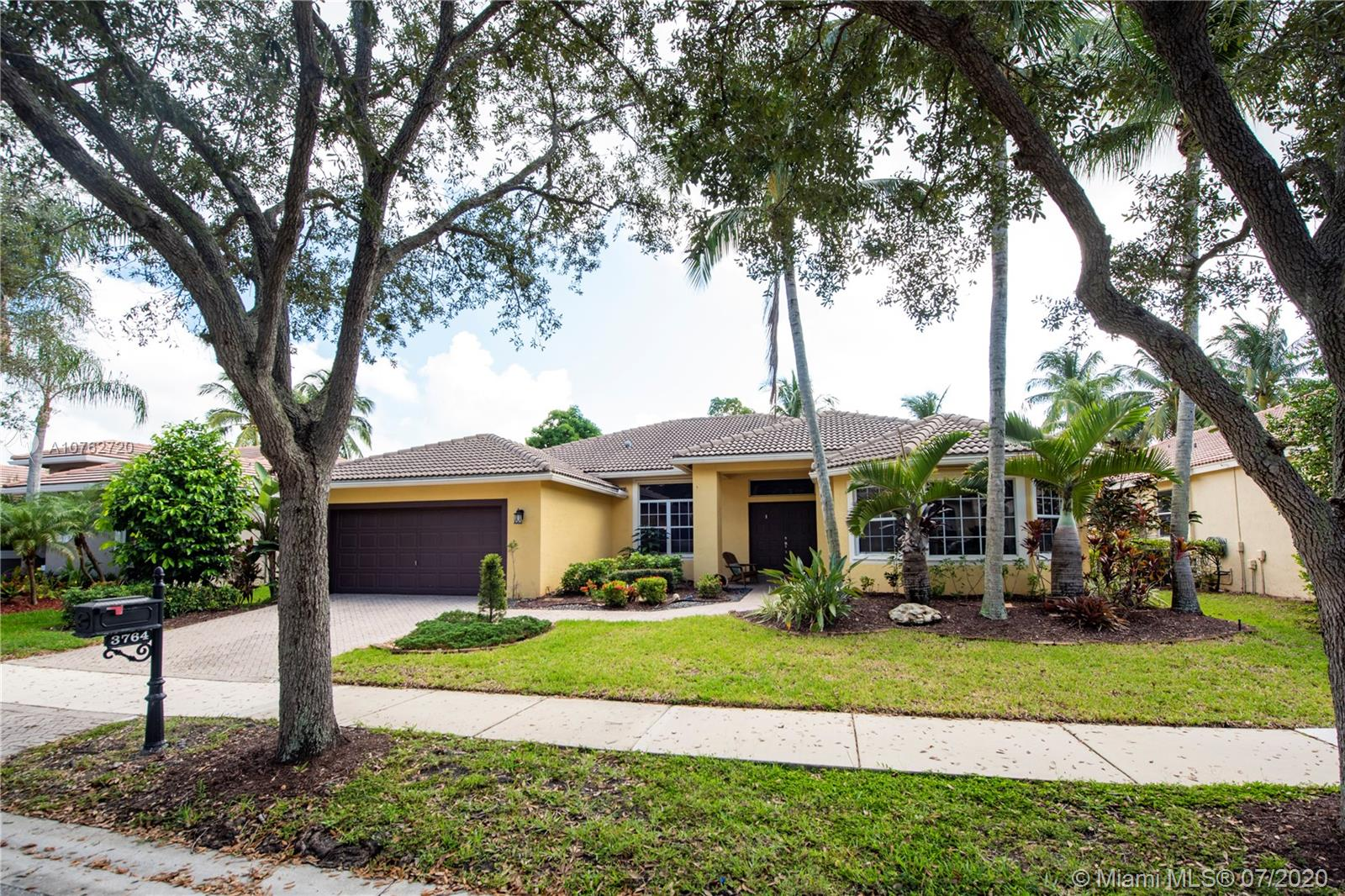 """Amazing opportunity to own a one story single family 5 bedroom 3 bathroom pool home in the desirable neighborhood of """"The Ridges"""" in Weston which features a guard gated entrance, walking paths, tiki huts, community pool, playground, basketball and ball fields!  Top rated schools in Weston!  This home is a """"must see"""" with a remodeled kitchen and bathrooms, tiled floors, wide open floor plan perfect for entertaining!  4 way split with one of the bedrooms being used as an office/den!  Lots of natural light!  Enjoy the view of the pool from the living areas and relax on the screened in patio perfect for outdoor entertaining!  Centrally located for easy access to major highway for commuting!"""