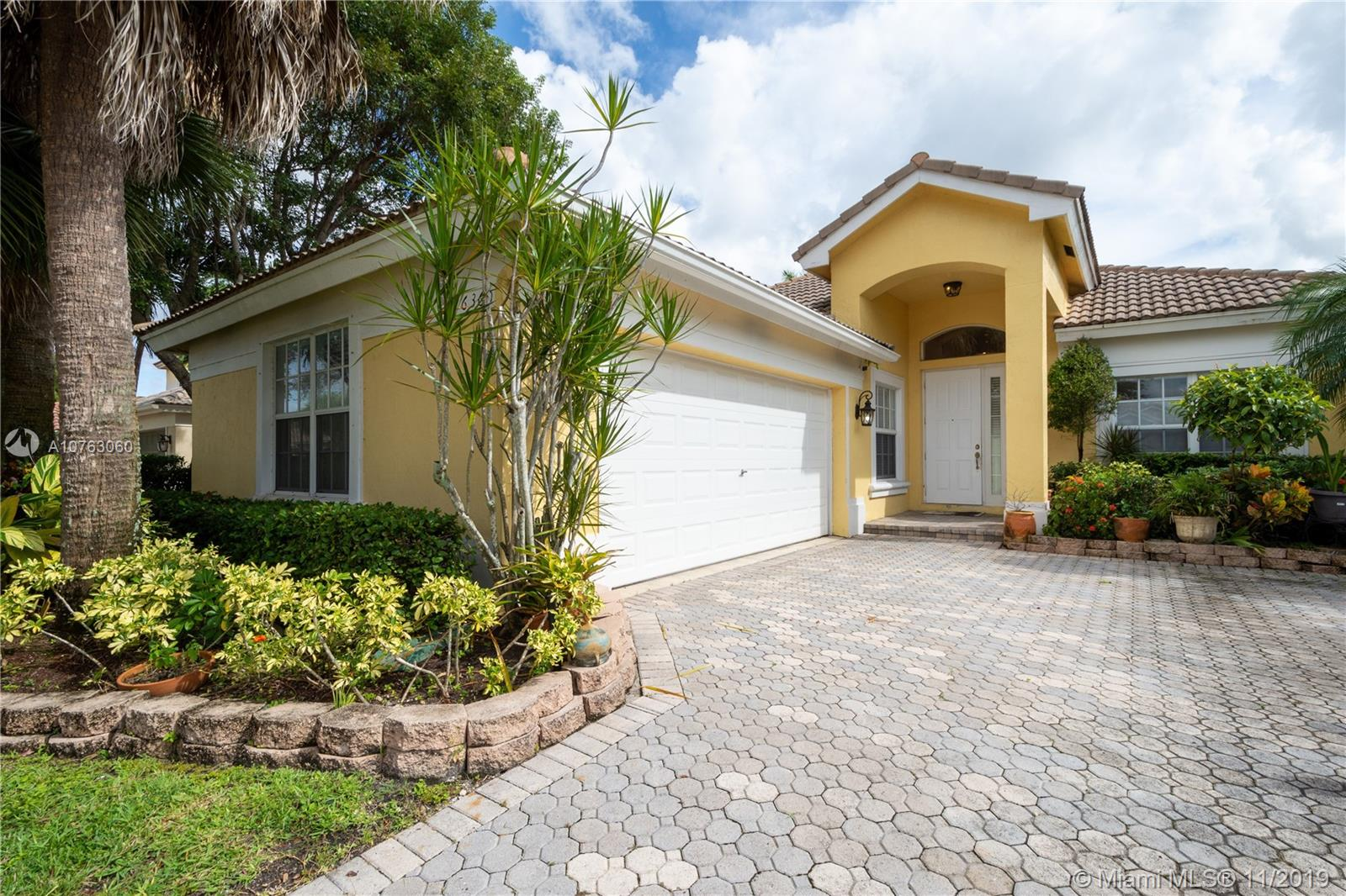 "Very nice inviting home  with large fenced in yard and covered patio overlooking gorgeous tranquil water views. 20"" tile on diagonal. Wood floors in master bedroom. Upgraded kitchen w/42"" wood cabinets, granite counters & backsplash, and S/S appliances. Speaker system throughout house. This won't last so hurry up and check it out! Guard gated community with Clubhouse, pool, exercise room, basketball, tennis, tot lot, plus more."