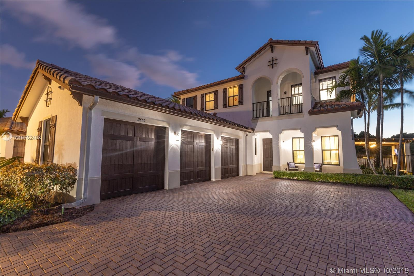 """TSFT is proud to present the best-in-class Tortuga model home located in sought-after Monterra at Cooper City. Situated on a quiet cul-de-sac, this home boasts an oversized lot with tropical privacy landscaping, custom swimming pool with built-in speaker, 180° sunset views by the lake, and a brand-new summer kitchen entertainment space with TV & surround sound. Walk inside to a massive open concept kitchen and professionally designed living areas. Conveniently, one bedroom is located on the ground floor, with 2nd level featuring an oversized loft, and 3 large bedrooms, including a master with an ensuite, his-and-hers walk in closets, and a private balcony. This """"Smart Home"""" has a Universal Remote System operable from your mobile device with 7 different speaker zones + surveillance cameras."""