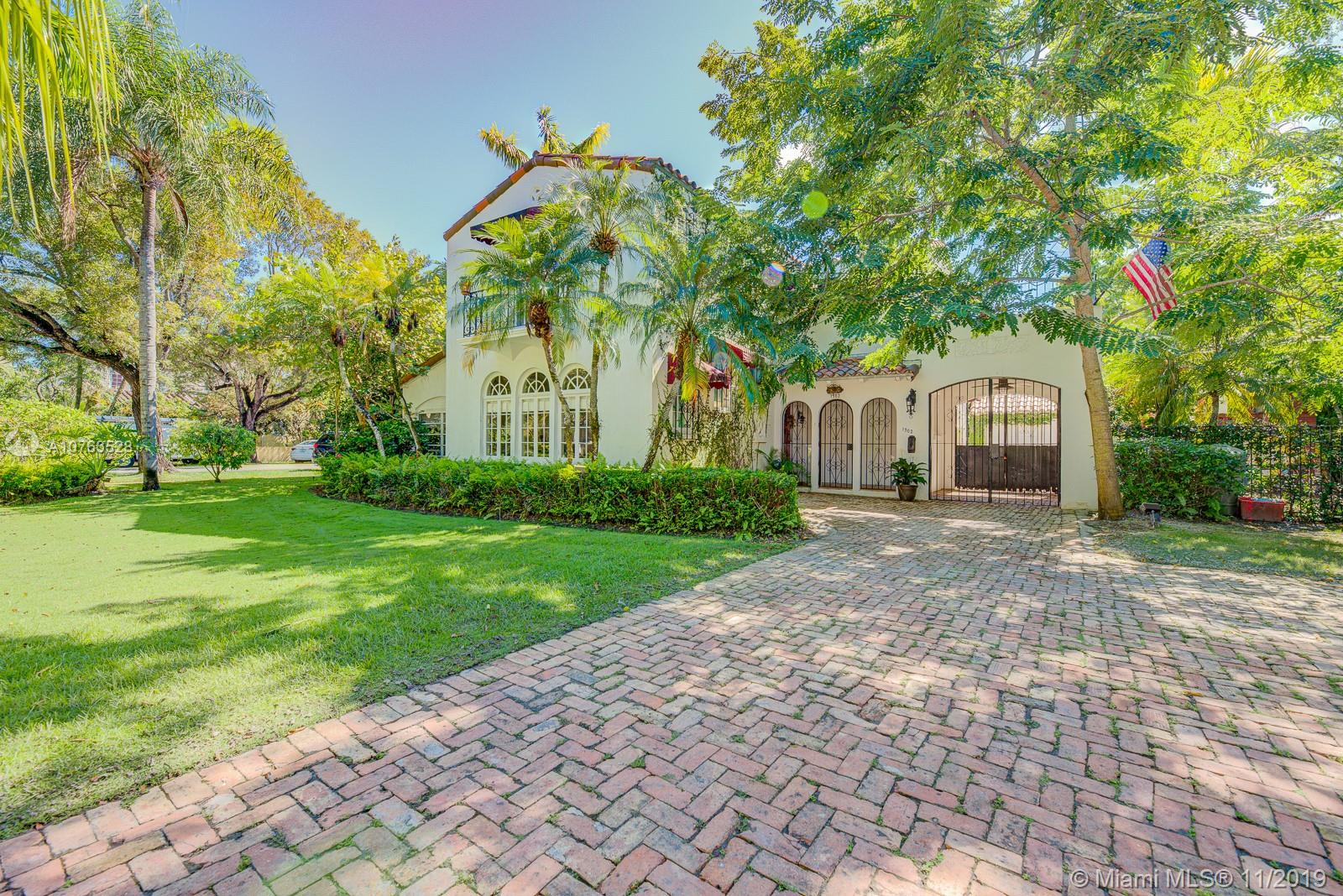 Opportunity to purchase a stunning landmark home on a14,505SF corner lot. Located on one of the most prestigious streets in Coral Gables, this historical residence features original finishes from the 1930s. Such as,immaculate terra-cotta and Florida pine floors, charming spanish tiles on the stairs,& stained glass windows. 1st floorhas a powder room, 2nd floor has 3 bedrooms and 2 full baths. 1/1 guest quarters next to 2 car garage.The tastefully upgraded kitchen is equippedwith Miele appliances:gas cook-top,2 wall ovens,warmingtray,  & sub-zero refrigerator.The kitchen opens up to the formal dining room overlooking the pool. This home has the perfect combination of charm and functional upgrades.