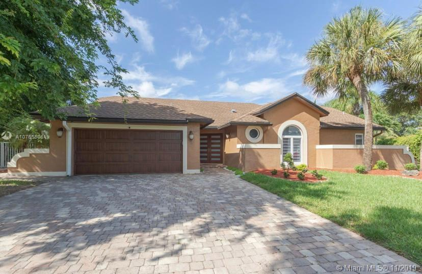 The best home in Coconut Creek is on the market! With nice modern decor, an amazing backyard with a pool, a volleyball court and a soccer field, this move-in ready home is perfect for your family. Your kids will never get tired of this dream backyard. You will also have your own barbecue grill and a tiki bar. There are 4 bedrooms and 3 bathrooms, and a stunning kitchen with ample high-end cabinets with quartz, a built-in microwave, dishwasher, and beautiful lighting fixtures. This home totally upgraded, over $150k in upgrades. Hurry before is gone. a guest house or Shed.