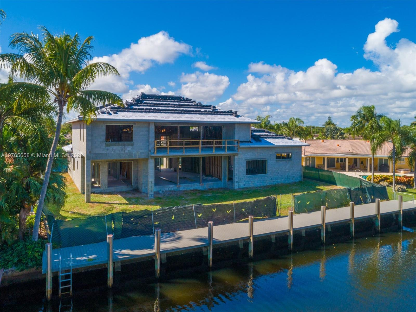 This BRAND NEW transitional modern deepwater estate sits on an oversized 12,000sf lot with 100ft of prime waterfrontage-- just one canal in from the Intracoastal. With incrediblewaterway views from every major room, this 5,500+/-sf home is an entertainer's dream. There's still time to pick finishes! Estimated completion- Summer 2020.