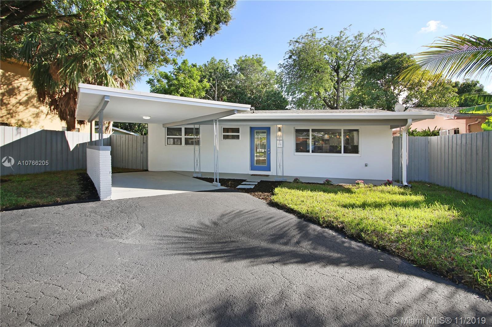 """FULLY REMODELED 2/2 with carport located just a short walk from Wilton Manors shoppes and restaurants!! Home features: NEW roof, NEW impact windows, NEW A/C and duct work, NEW hot water heater, NEW electrical panels, and brand NEW washer and dryer. Open concept kitchen has been fully upgraded with: waterfall edge quartz countertops, white shaker cabinets, stainless steel appliances, and custom lighting. Both bathrooms have: new fixtures and vanities, new tile, bluetooth speaker fans, new tub (second bath), new frameless shower glass master bath (to be installed). Entire home features beautiful new 24"""" marble-look porcelain tile and 5.5"""" baseboards throughout. Fenced yard is private and perfect for your pets and for entertaining, with plenty of room for a pool! This home is a MUST SEE!!"""