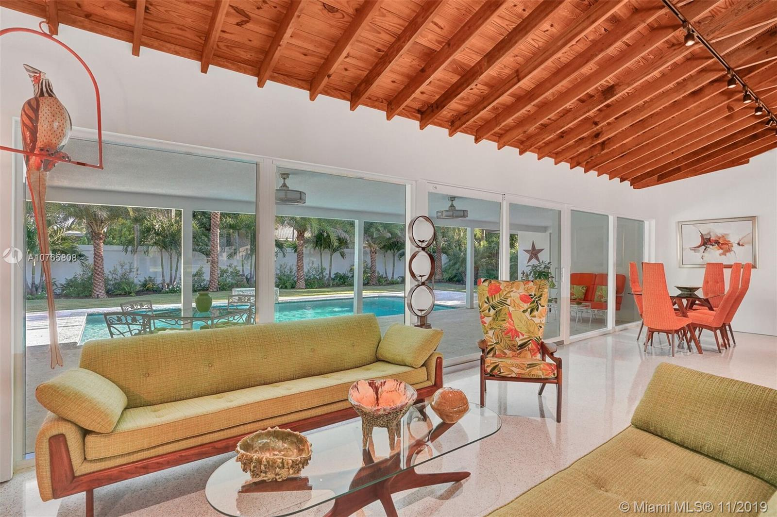 AS FEATURED IN THIS MONTHS TROPIC MAGAZINE! Museum-quality renovation in this mid-century modern 3 bed 3 bath residence.Marvel at the 13 ft cathedral, wood-beamed,ceilings & polished terrazzo floors.No expense has been spared in this incomparable residence. Open chefs kitchen includes a Wolf gas range,Kitchen-Aid applic and Mahogany cabinets. Split bedroom plan positions the spacious master suite across from the other 2 bedrooms.Master suite include 2 custom baths.1 boasts a spa-styled soaking tub & shower, the other features a seamless shower.Step from the master suite onto an over-sized covered patio adjoining the coral rock paver decked resort-style pool.Custom landscape lighting highlights tropical foliage. All New Plumbing, Electrical, Windows!