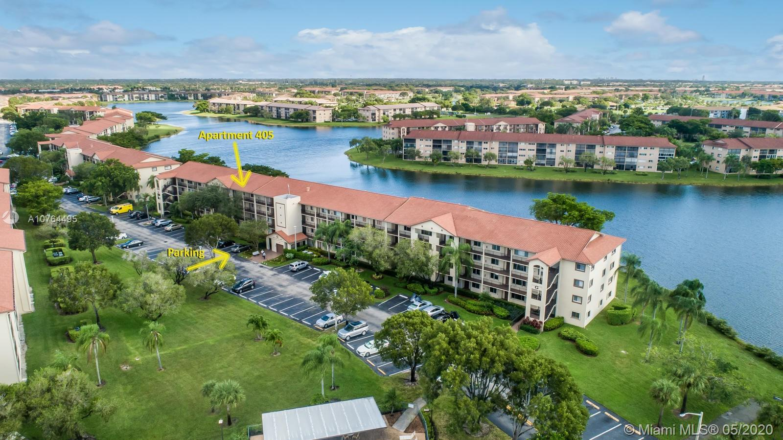 LOCATION, LOCATION, LOCATION!!! FANTASTIC TOP 4TH FLOOR 2/1.5 CONDO WITH STUNNING LAKE VIEWS IN THE NEWER SECTION OF SUFFOLK. CLOSE AND CONVENIENT TO MAIN ENTRANCE OF CENTURY VILLAGE. PERGO FLOOR THROUGHOUT, BRAND NEW A/C, ELECTRIC RANGE, DISHWASHER MICROWAVE, WASHER AND DRYER. MASTER BATHROOM IS HANDICAPPED EQUIPPED AND MASTER BEDROOM HAS MOTION SENSOR LIGHTING. ASSIGNED PARKING SPOT IS IMMEDIATELY ADJACENT TO MAILBOXES AND ELEVATOR AND CLOSEST BUILDING TO HEALTH CLUB/GYM. ELEVATOR AND ROOF HAVE RECENTLY BEEN REDONE IN BUILDING. COMMUNITY OFFERS: WATER, CABLE AND AMENITIES SUCH AS GYM, BILLIARD ROOM, TENNIS, HEATED POOL, GOLF, THEATER, CLUBHOUSE, SHOWS.