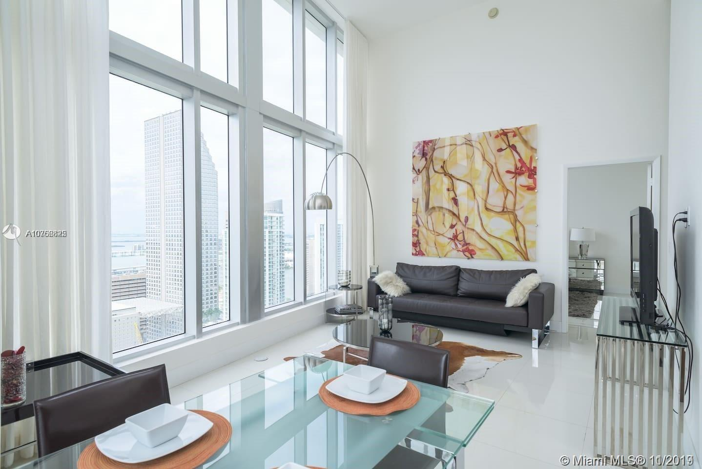 16FT Ceilings & incredible views!! Fully furnished by Tui Lifestyle, Top-of-the-line appliances, curtains throughout & blackout blinds in the bedrooms, move-in ready. Short term possible. Text agent for pricing and showings