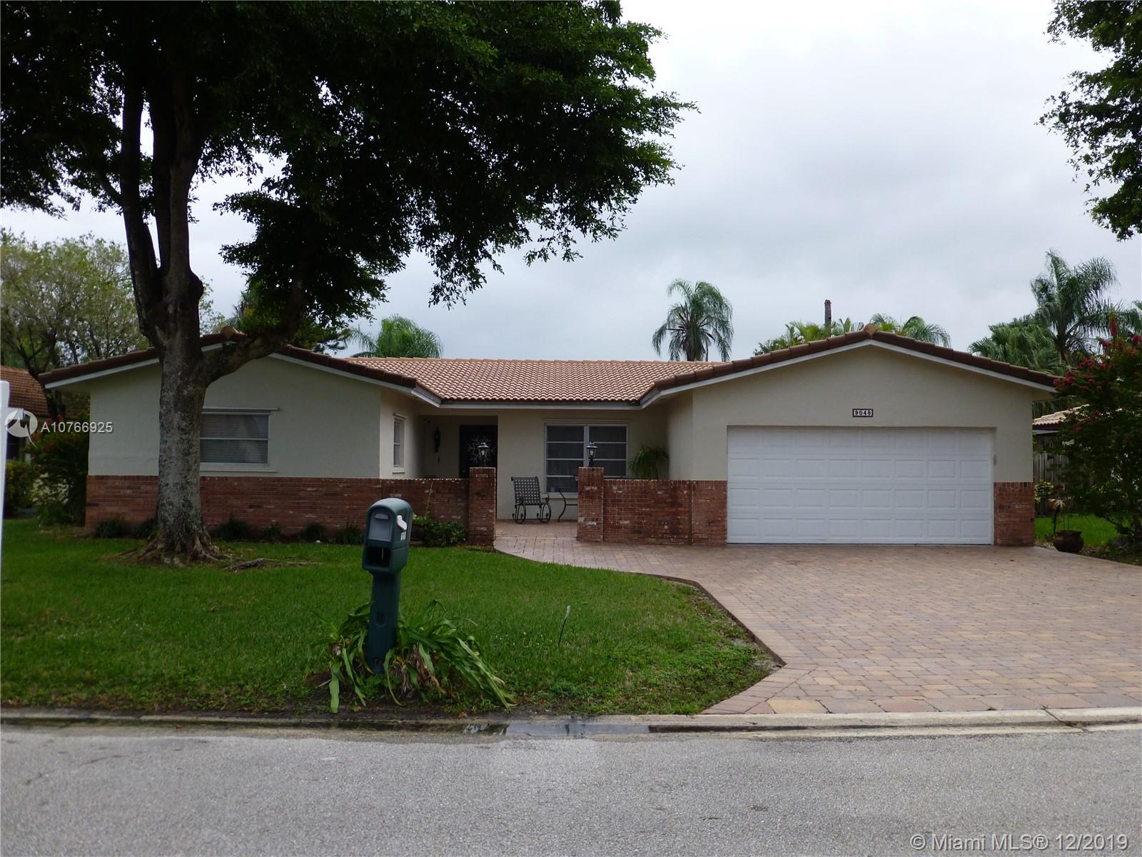 Beautiful 4 bedroom, 2 bathroom home in the heart of Coral Springs! This single family home has a  fully remodeled kitchen, with gorgeous antique white cabinets, granite countertops, and Edison lighting. Both bathrooms are also tastefully remodeled. Wide driveway with beautiful pavers that lead up to the front door. All interior walls have been repainted in calming neutral colors. This home also features a screened in pool with travertine decking prefect for entertaining! Bonus-there is no HOA! Close to restaurants, shopping, hospitals, and expressways.