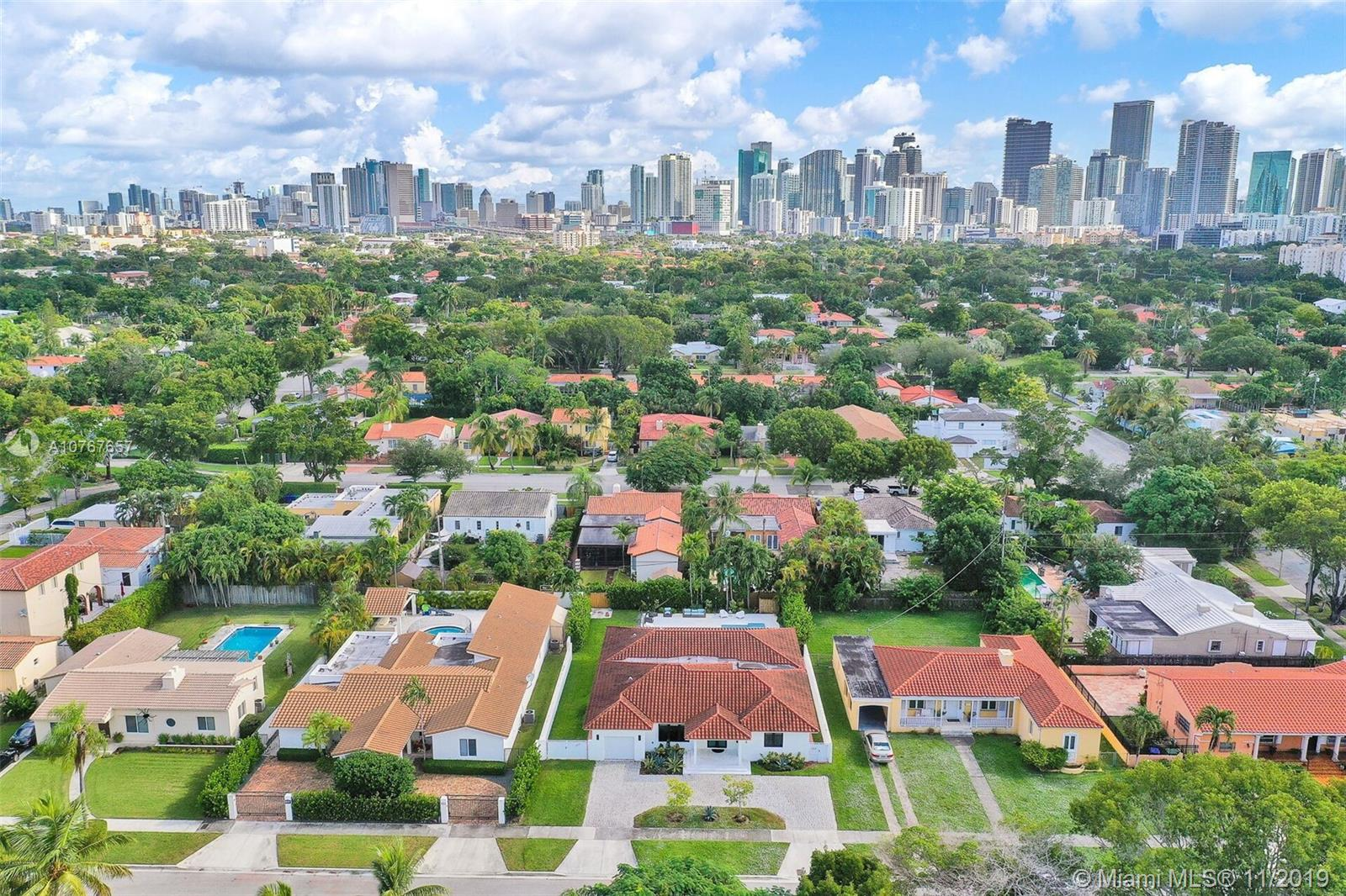 Back on the market this beautifully remodeled Roads Residence minutes from Brickell & Downtown Miami. large 4 bedrooms 3.5 bath pool home with over 3500 sqft on a 10,575 lot was completely remodeled in 2017 with no expenses spared. Open concept living at its finest with beautifully refinished Dade Pine flooring throughout, custom Italian gourmet open kitchen with large center island quartz counters and new S/S appliances overlooking a large family room. The large master wing is nestled away for privacy and includes a generous walk-in closet, sitting area, and spa-like master bath to relax in. The large open terrace overlooks a new saltwater pool and beautiful private walled-in backyard and that includes cabana bath. New A/C units, impact windows and doors, updated electrical and plumbing.