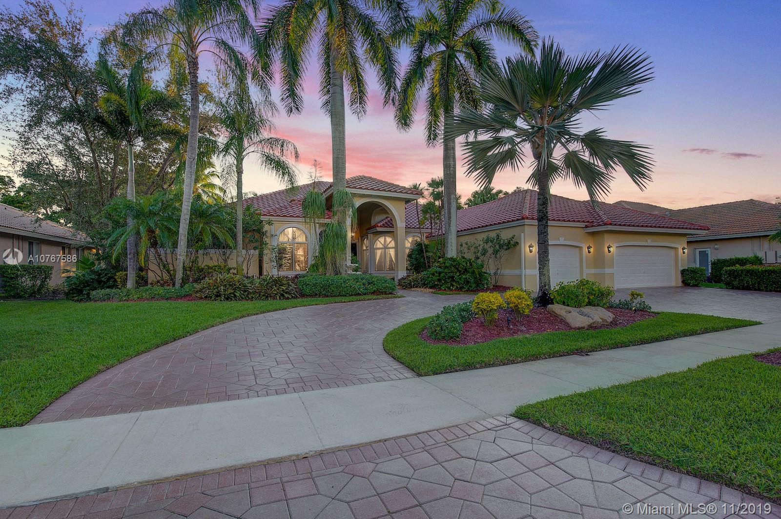 You are embraced by elegance as soon as you enter this custom designed one story pool estate home boasting 5 bedrooms, 4.5 bathrooms +Library/Office & a 3 car garage! BRAND NEW ROOF JUST MONTHS OLD!! Gorgeous pool & tranquil waterfall views as soon as you enter the property sets the stage for the grand foyer! Freshly painted interior & exterior! This home shows complete pride of ownership. Meticulously maintained with high end custom design touches throughout the home. High ceilings, crown molding, marble flooring and luxurious finishes. Chefs kitchen! Fantastic backyard with an outdoor terrace and grill/summer kitchen area. Located in the prestigious gated community of Weston Hills Country Club. Excellent location near major highways, restaurants, shopping, top rated schools and more!