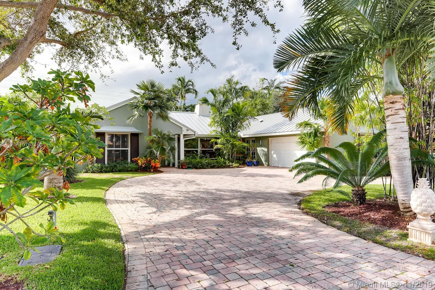This exquisite Coral Ridge Country Club residence has it all! Prime location minutes away from the beach and walking distance to the golf course. 3 bedrooms, 2.5 bath with covered patio, patio wet bar and heated saltwater POOL! Home interiors include rich hard wood floors throughout, white cabinetry in kitchen with quartz counter-tops and stainless steel appliances. Main living area boasts pool views with a near full wall of sliding glass doors that can be opened wide to enjoy the Florida sea breeze in your tropical oasis. New roof, HVAC, A/C Ductwork, sprinkler system, impact Windows throughout entire home, and so much more. Schedule your showing today!