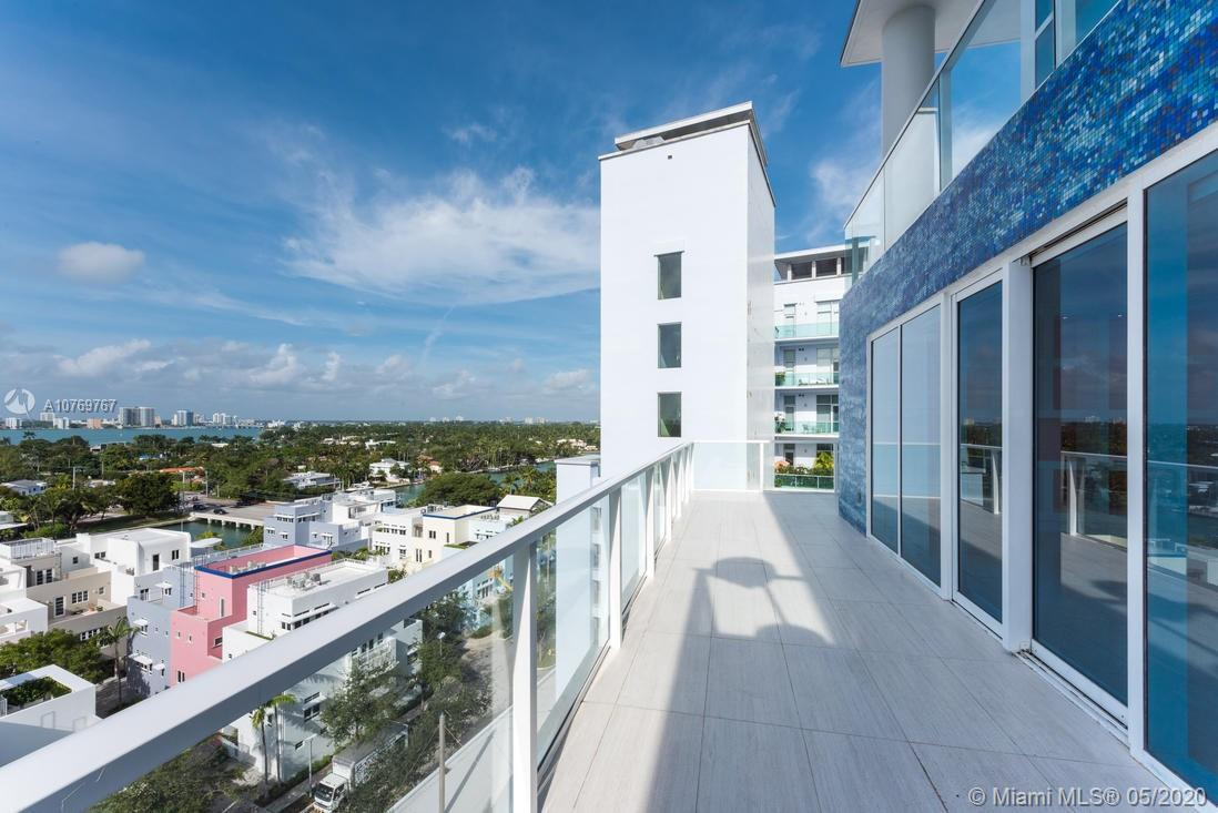Enjoy Luxury living in one of the most beautiful units at Aqua at Allison Island!! A Private Island located in the heart of Miami Beach. This light and spacious 3 bedrooms and 3.5 bathrooms features limestone marble floors and Brazilian cherry wood floors, open kitchen with top of the line appliances. Fantastic 550 sq ft of wraparound balcony off the Living area with breathtaking Bay and City views. Oversized master suite with large walking closet. Luxury amenities: 24 hours valet, two heated swimming pools, spa, 6,000 sq ft fitness center, concierge, 24 hours of security, children play room and access to private docks. Unit comes with two parking spaces #120 and #176.