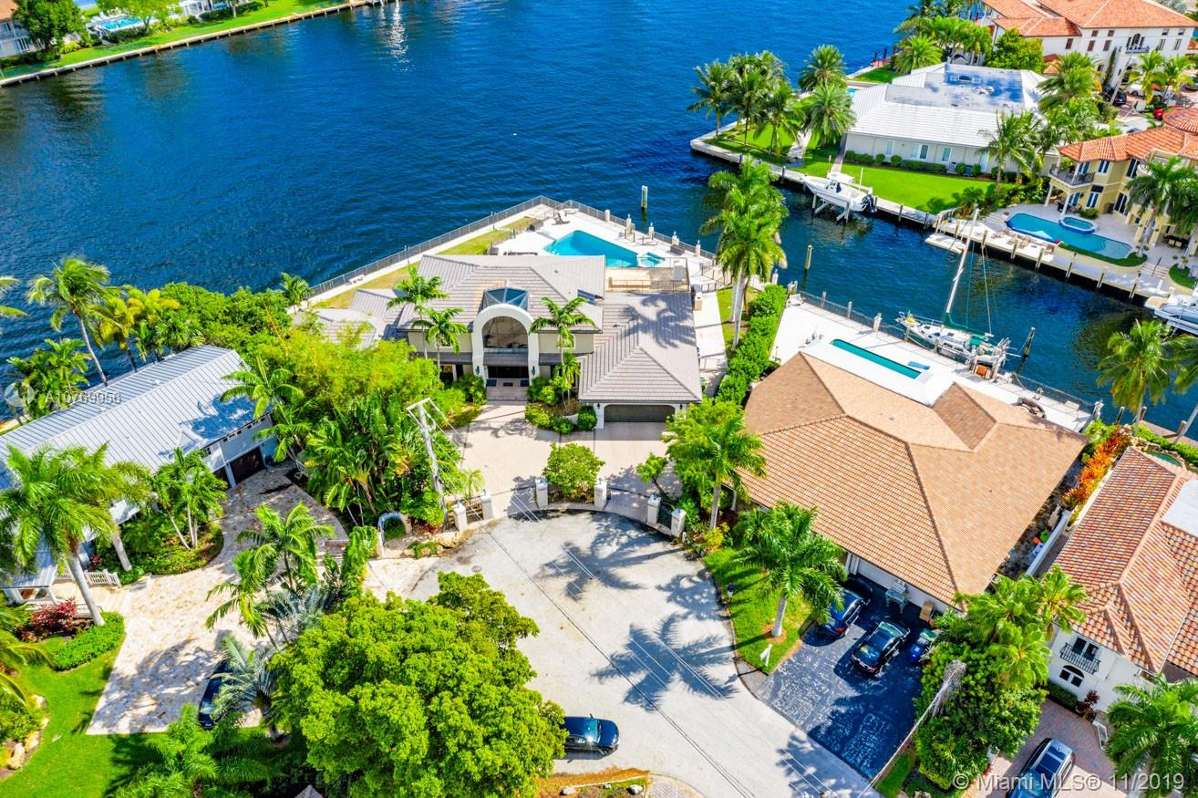 One-of-a-kind, corner point lot on the intracoastal! Stunning six- bedroom, five-bath property features grand staircase with wrought-iron stair railings, floor to ceiling windows showing off incredible views, huge gourmet kitchen (large island, stainless steel, high-end appliances, double ovens, redone countertops and cabinets, etc.), updated bathrooms, wrap-around balcony, luxurious pool on the water and so much more. So many features to list! Make this your dream home today.