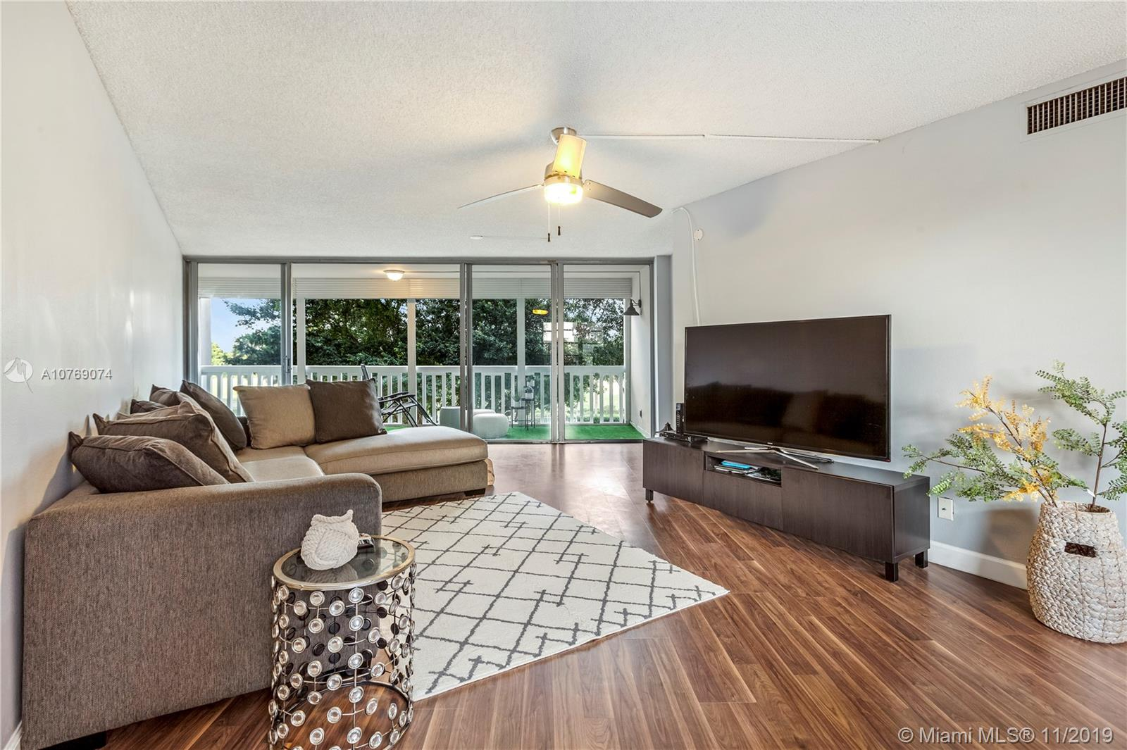 Renovated two bedroom, two bathroom unit features granite countertops and stainless steal appliances. Expansive sliding doors over looks the pool and the golf course. Unit has assigned covered parking space. You will love this spectacular unit.