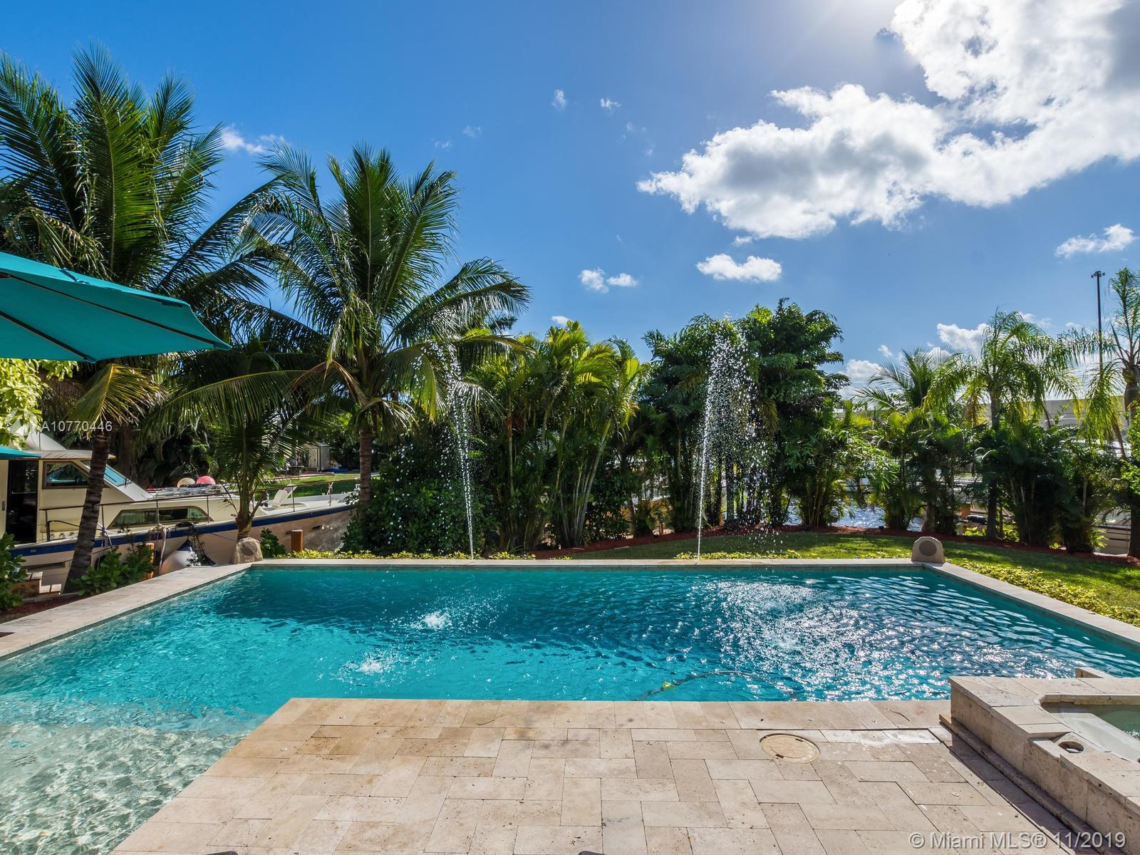 A rare point lot featuring 150 foot waterfront, 30/50A electric and water on a canal and New River, ocean access and no fixed bridges. Park up to 3 large vessels or even a catamaran right in front of your 3 bedroom 2 bath split level home! Kitchen features quartz countertops, soaring ceilings, impact windows throughout with hardwood and terrazzo flooring. Enjoy the newer travertine patio overlooking a custom heated pool and spa, plenty outdoor seating with incredible privacy. Side access allows for ample parking. Lush tropical landscaping, with mature fruit trees on one of the largest lots in Lauderdale Isles is the epitome of Florida's lifestyle. hurry, this won't last!