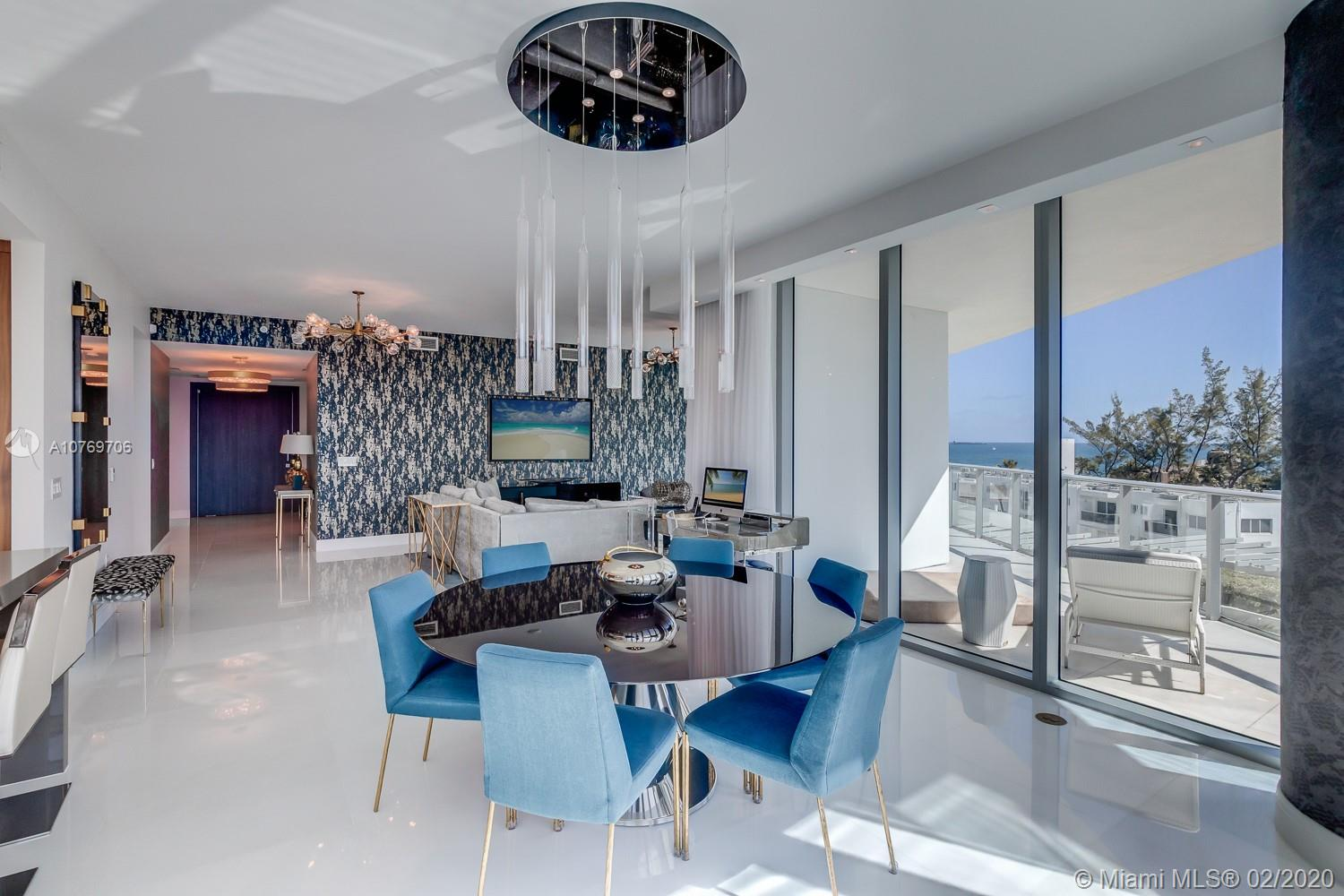 """Magnificent turn-key 3-bed, 3.5-bath corner unit w private elevator, spans 3,558 sf w/2 oversized balconies and endless city & ocean views. Custom interiors w modern white Thassos marble floors, Italian cabinetry, Subzero & Wolf stainless appliances, 10 ft ceilings, 8' solid core doors, upscale furniture, area rugs, lighting, & artwork, automated electric shades/drapes, security cam, audio, & TV's. Master suite features expanded custom closets, beverage station, marble bath, spa tub, rain shower, & automated commode. Paramount is a 5-star complex w full beachside services, pool w/cabanas, poolside bar, state-of-the-art fitness center, TV room, massage, steam, sauna, Paramount's signature, """"Above & Beyond"""" concierge services, integrated smart building technology, & on-site restaurant."""