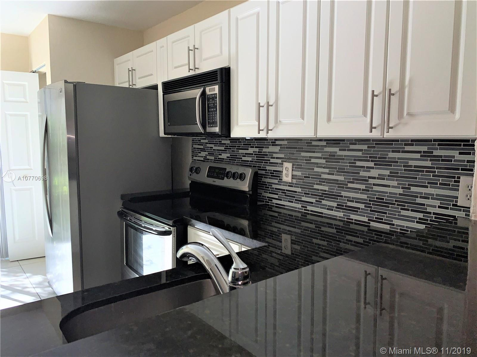 Updated 1st floor unit with patio in a Gated community ceramic floor and laminate in the bedrooms, upgrade kitchen cabinets and counter with stainless steel appliances. Community pool , Guard at the gate Easy access to Turnpike, Keys, Homestead Baptist Hospital and local amenities. Section 8 is OK