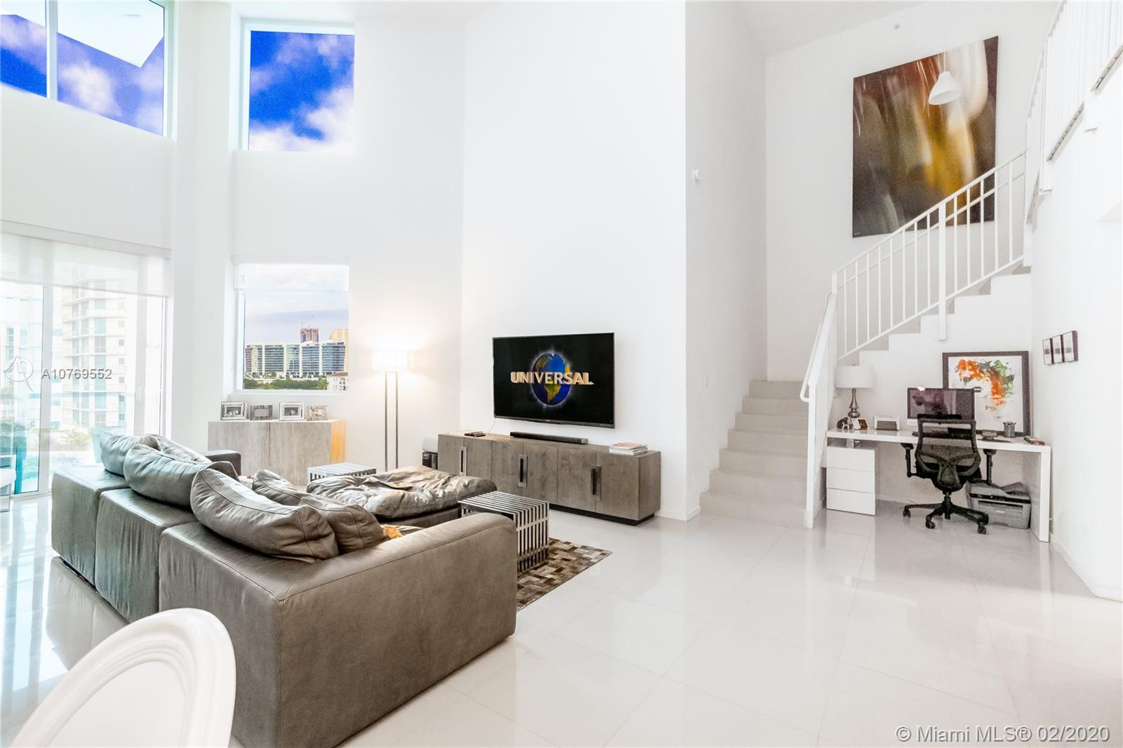 2 Story- Loft  Style  -2,360 SF  Facing the Parc and the bay  with a large terrace for entertaining .2 bedrooms+1 den (Can be easily converted into a 3 bed ) Contemporary Style. The property features  18 ft high ceilings,Porcelain floor, High end finishes .Boutique Building includes  the security, an outdoor pool with sundeck, state-of-the-art spa and fitness centers, concierge, covered terraces, clubhouse with lounge, along with three  elevators.3030 Aventura  is steps away from Aventura's first charter elementary school,recreation center, Parc , Shopping center and Aventura Mall.2 Parking spaces assigned. Internet & cable are included on the maintenance fees .