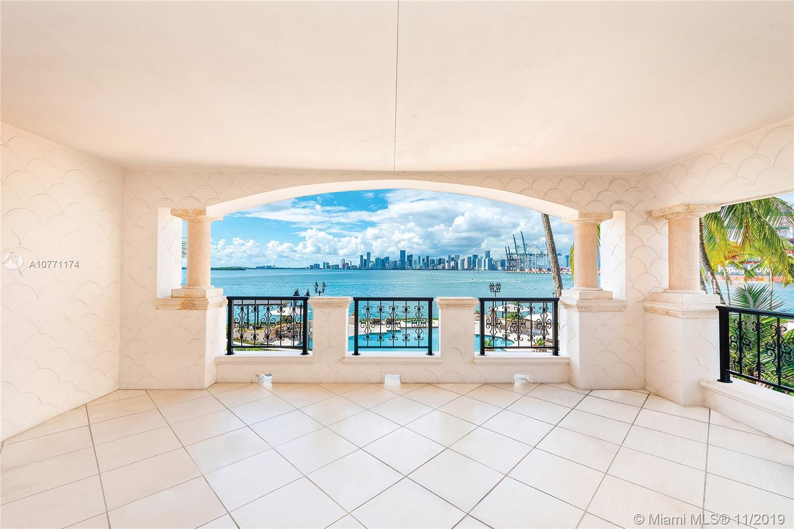 This beautiful corner unit on Fisher Island offers amazing unobstructed panoramic sunset views of the Miami skyline and Biscayne Bay. The 5200 building has been completely renovated to new condition plus beautiful water features have been added. The 3BR/3+1BA unit is ready to move in and features 2,740 square feet of interior space, marble floors throughout, large living and dining area with access to a wrapping terrace with direct open bay and downtown Miami skyline views. An open kitchen features a separate breakfast area and step-out access to a private side terrace with bay views. The master suite faces Biscayne Bay, and sports a marble master bath with double sinks and a sunken spa tub. This unit is a must see.