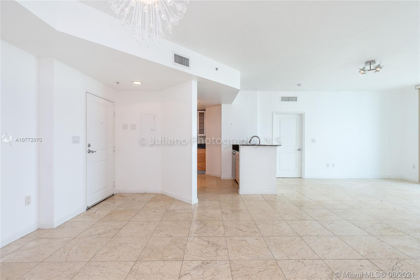 ENJOY BREATHTAKING UNOBSTRUCTED VIEWS OF MIAMI AND BISCAYNE BAY FROM THE SPACIOUS BALCONY OF THIS LOVELY CONDO LOCATED IN THE LUXURIOUS 360 CONDOMINIUM! IMMACULATE MARBLE FLOORS IN LIVING AREA. MASTER BATHROOM INCLUDES OVERSIZED JACUZZI AND SHOWER. THE KITCHEN IS EQUIPPED WITH TOP OF THE LINE STAINLESS STEEL APPLIANCES. BUILDING OFFERS A VARIETY OF AMENITIES, INCLUDING A PRIVATE MARINA, TWO POOLS, AND FITNESS CENTER WITH FREE VALET PARKING AND MUCH MORE!