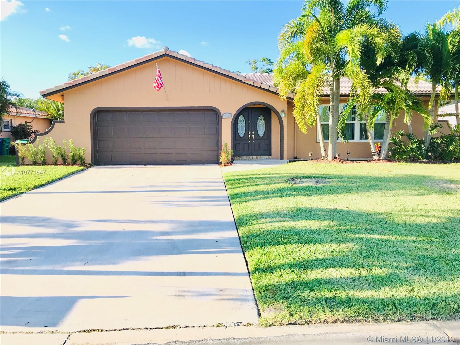 Immaculate, spacious and great starter home in the hearth of Coral Springs, come and bring your personal touch to this lovely one story single family house with 3 bedroom, 2 bathrooms (1 cabana bath), wood burning fireplace. Enjoy a gourmet kitchen with pool view, double oven, custom cabinets, stainless steel appliances, granite countertops. This home also features build in bar, 2 car garage, huge driveway, impact windows, shutters, beautiful pool, patio, and pool area to entertain.  Dont miss this great opportunity of enjoying this home in the quiet Ramblewood Community, close to restaurants, malls and excellent schools.