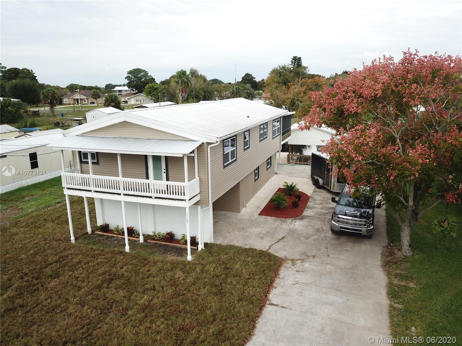 1169 Canal Way, Other City - In The State Of Florida, FL 34974