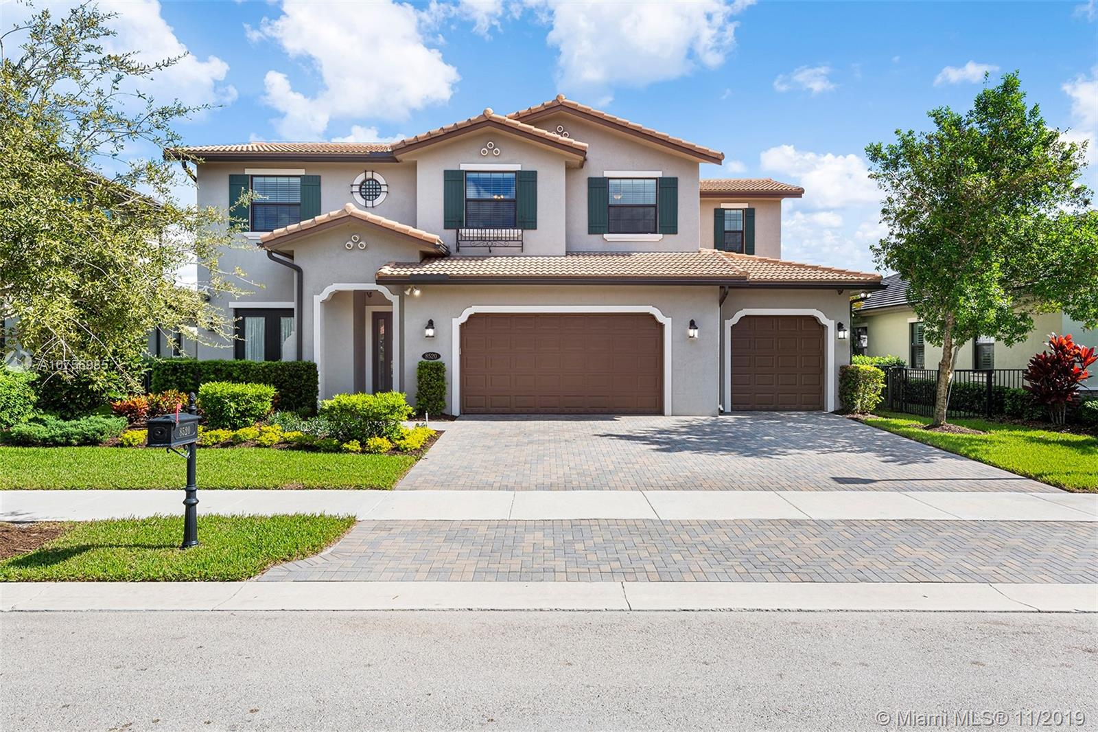 "This new Parkland lakefront home features an open concept living and kitchen area with SS appliances, granite countertops, a gas range and a massive island. 24"" porcelain tiles throughout the common areas, custom built-ins, a whole house generator, with handicapped accessible finishes, and $235,000 in upgrades. Expansive screened in patio with East exposure and a heated salt-water pool perfect for entertaining. The large master suite combines water views with a luxurious bathroom and walk in closet. The gated neighborhood of Watercrest includes a grand clubhouse with a beach-entry pool and spa, a dock, two tennis courts, a basketball court, kids play area, gym, steam room, ballroom and a barbecue pavilion."