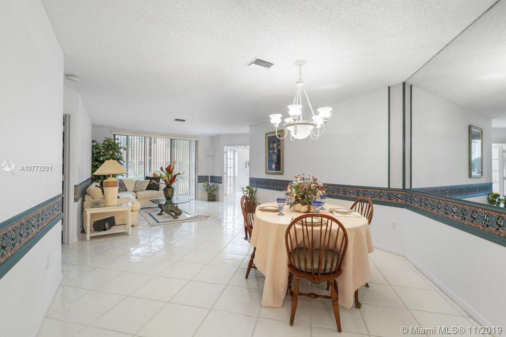 Beautiful and spacious 3 bedroom 2 bath 1st floor condo with garden and lake view. No age restrictions. Tiled floor in main living areas. Spacious eat-in kitchen with granite counters and new stainless steel refrigerator and stove. Split bedroom plan. Full-size washer (new) and dryer. Screened and glass patio. 3rd bedroom converted to a den with built-in shelves. Heated community pool. Fantastic amenities for all ages including huge community center, Olympic size pool, fitness center, theater. Assn fees of 363/mth Bavview and $158/qtr Township include cable, water,lawn, trash, pools, fitness, community amenities. Assn requires approx 30-day approval, credit score 650+, min 10% down.