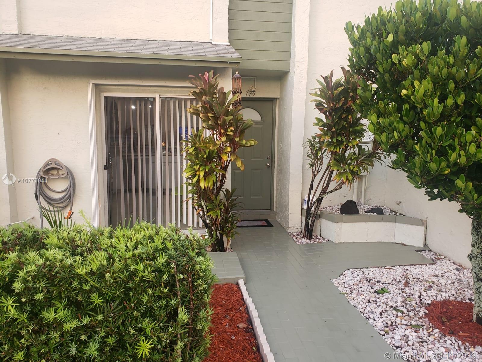 Updated 2/2.5 townhome conveniently located in Deerfield close to I-95, Turnpike, shops and restaurants. No carpet! Tiled on First Floor. Laminate flooring on stairs and second floor. Freshly painted. New Hurricane Accordion Shutters installed in 2018. Air Handler 1 year old. Updated kitchen with new stainless steel appliances. Bathrooms recently updated with new vanities. Each bedroom has their own bathroom and walk in closets. Separate Laundry area on first floor with full size washer/dryer. Security system with 4 cameras, 2 in the front and 2 in back of property. Nice backyard with screened porch patio. 2 Parking spaces conveniently located in front of your door plus guest parking. Come and enjoy the Community pool and club house.